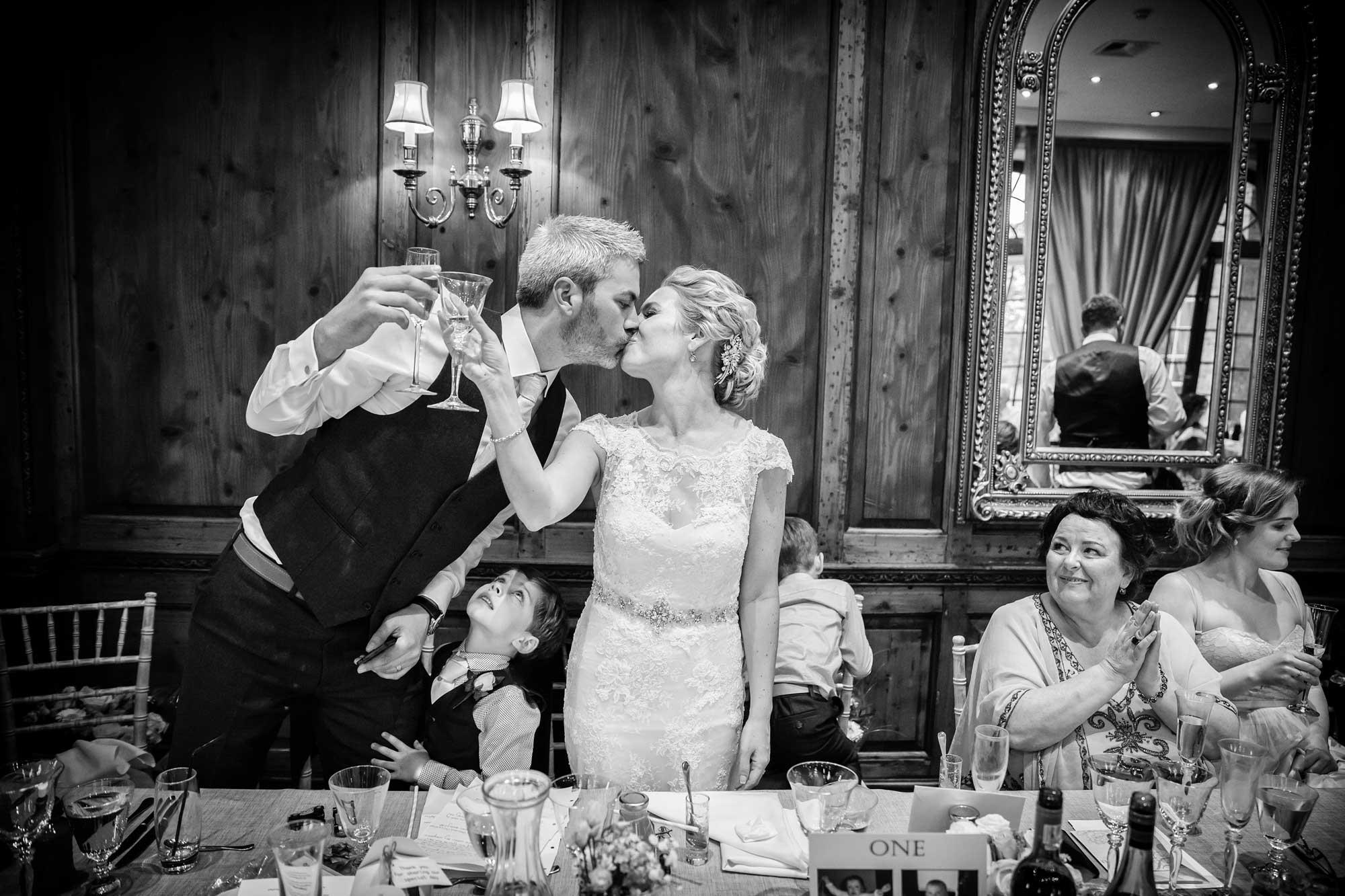 kiss at chislehurst wedding