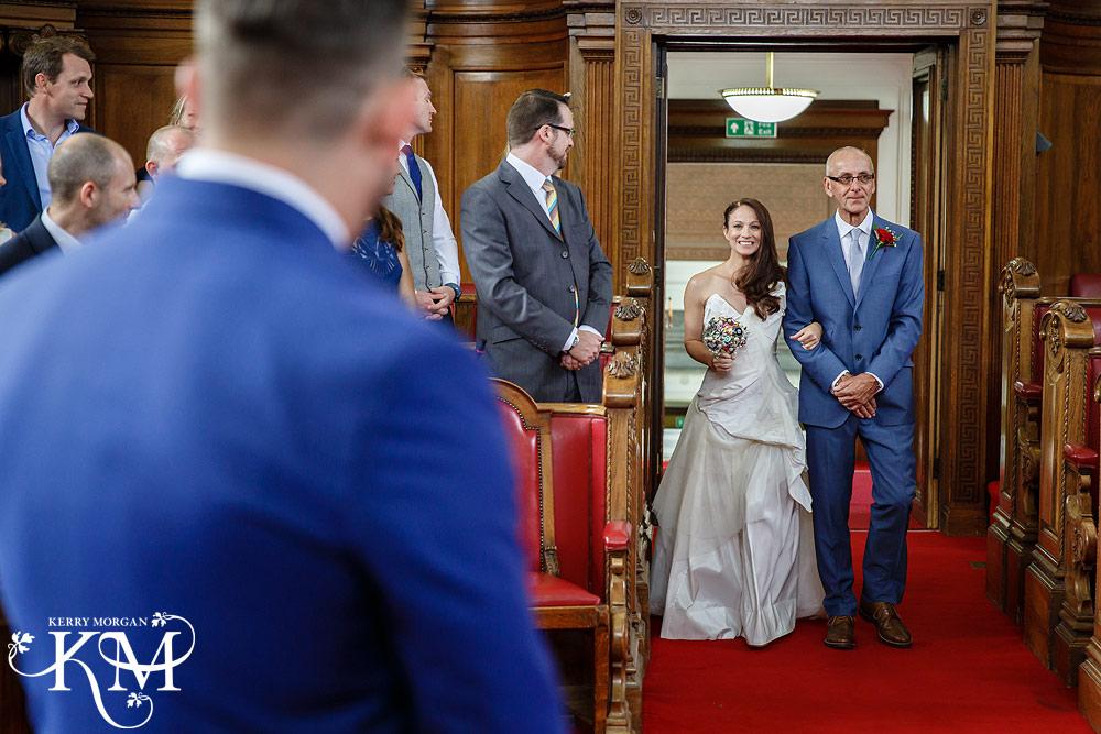 bride and dad walk into at Islington Registry Office Wedding