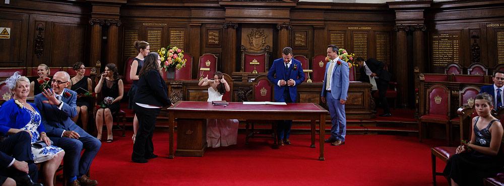 Islington Register Office Wedding signing the register