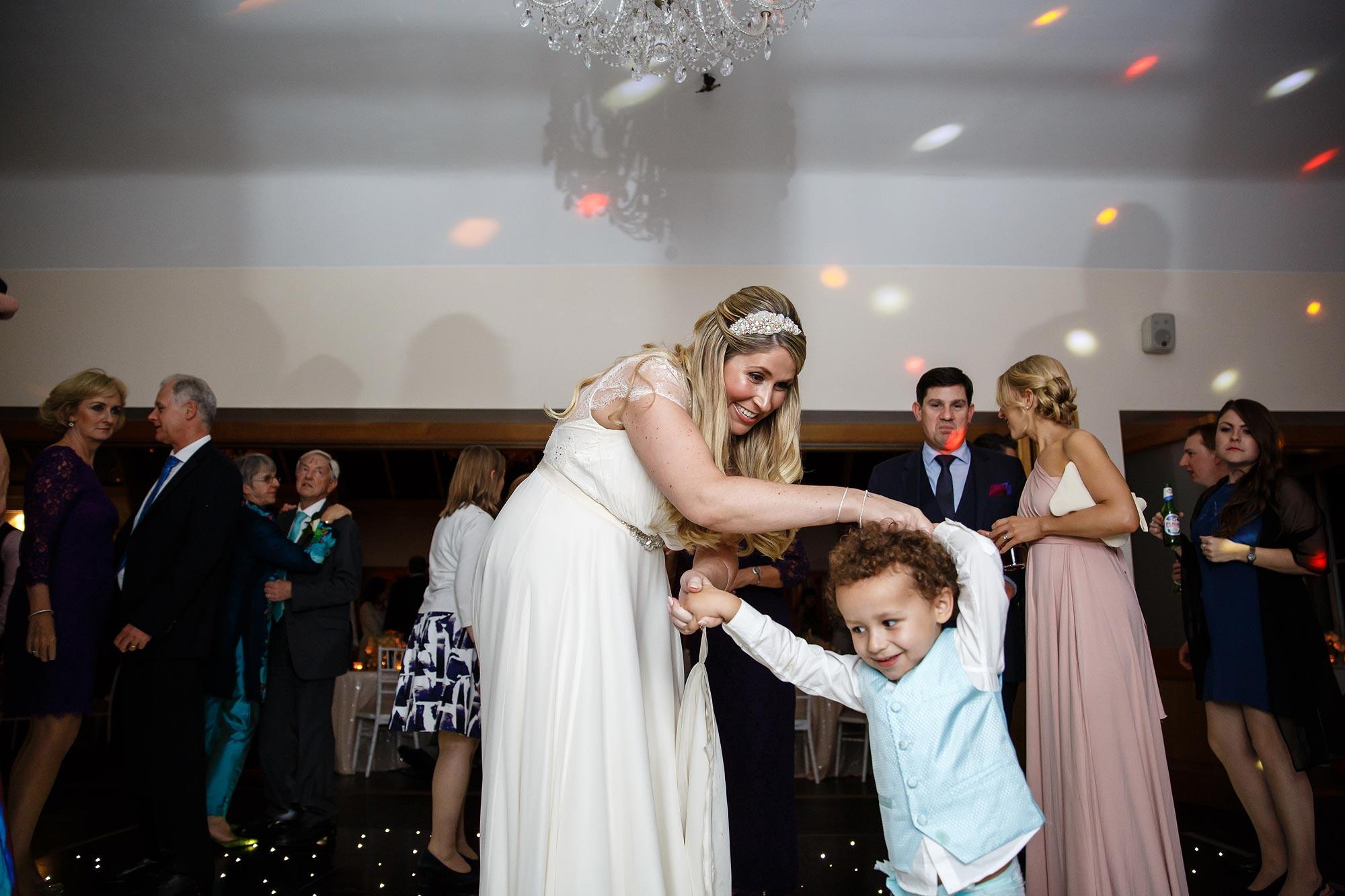 bride dancing with page boy
