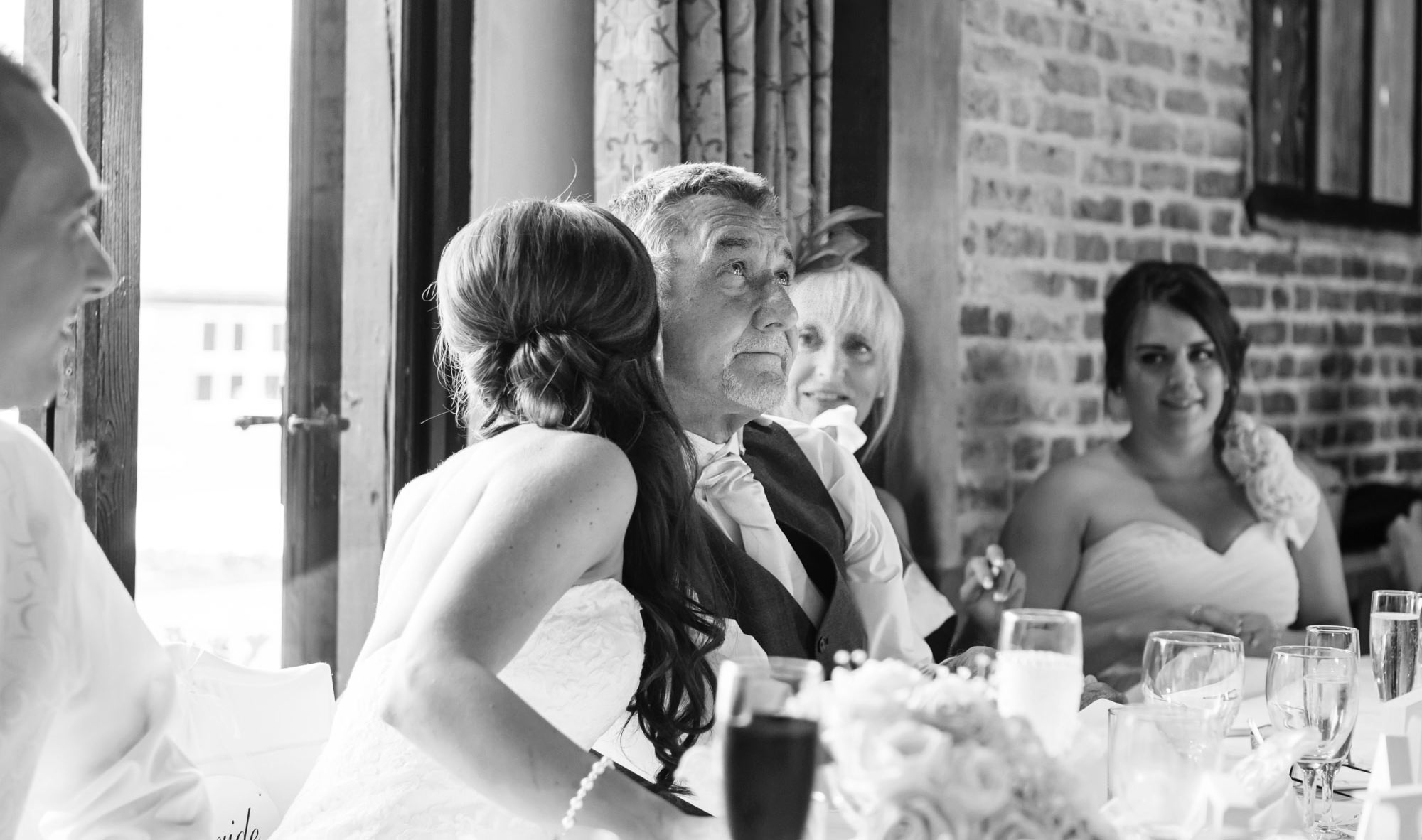 bride kisses father at leez priory wedding