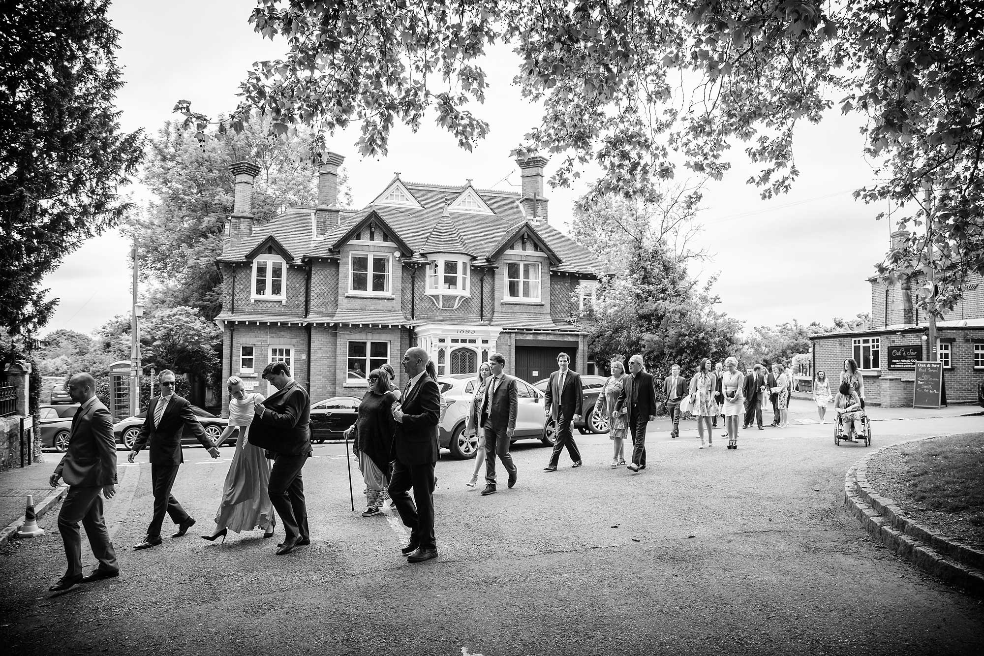 guests walking over road at wedding