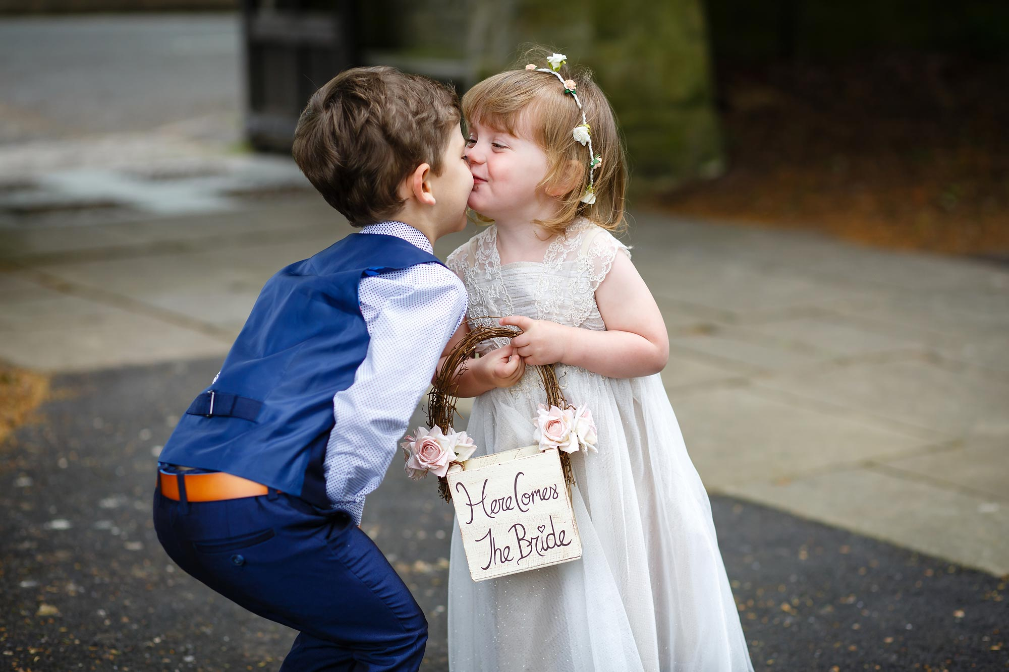 page boy and flower girl kiss