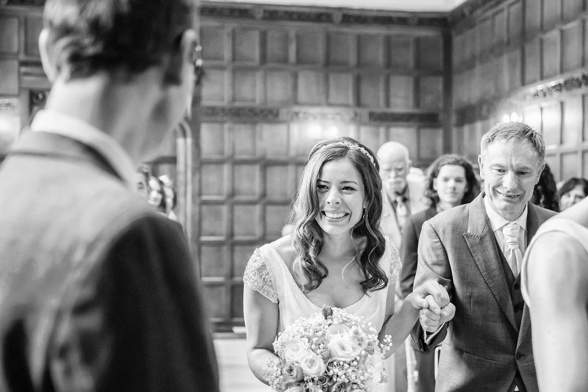 Amy smiles at Jack as she walks down the aisle on the arm of her Dad