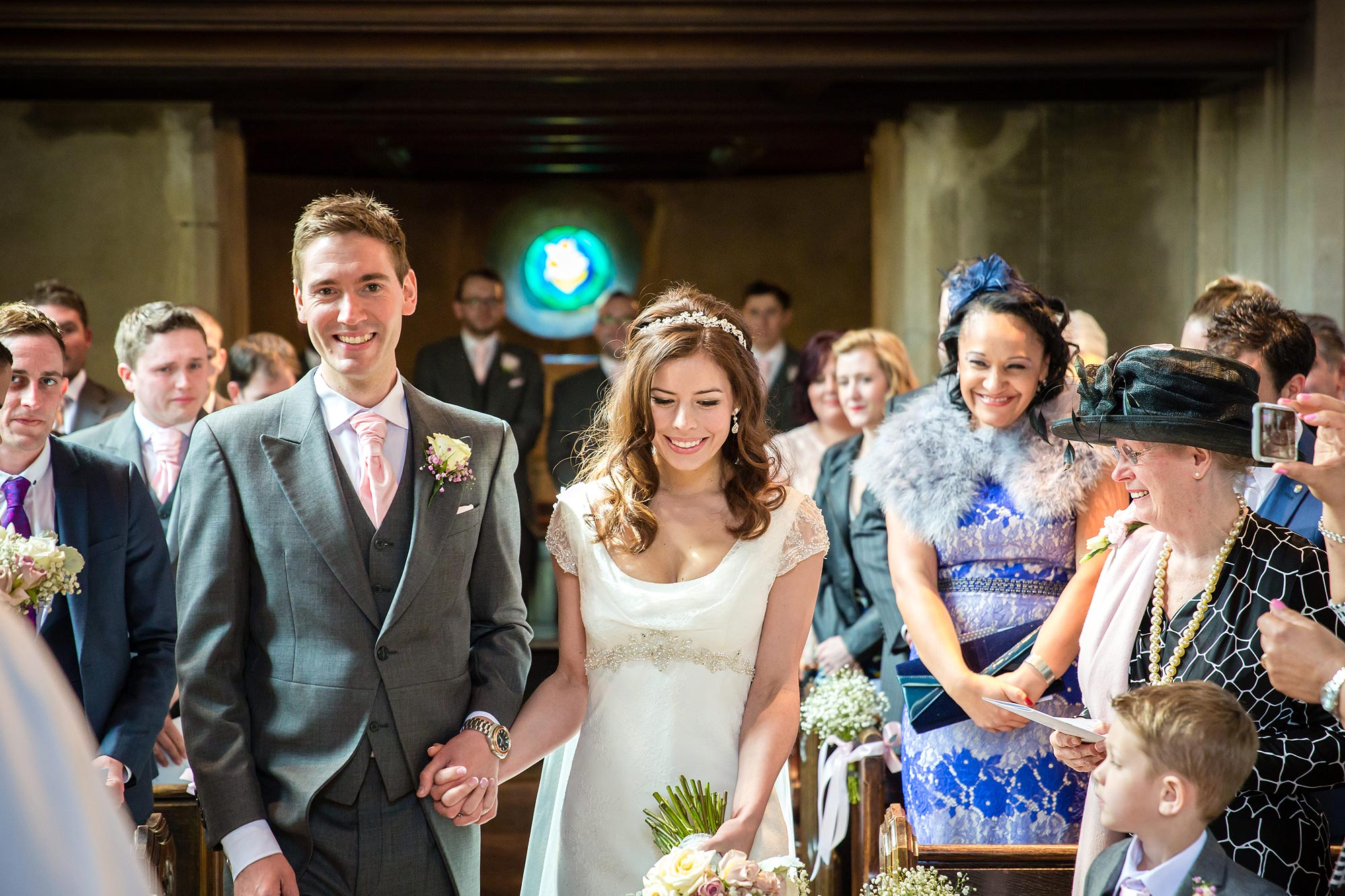 The couple enter Hengrave Hall church for a blessing