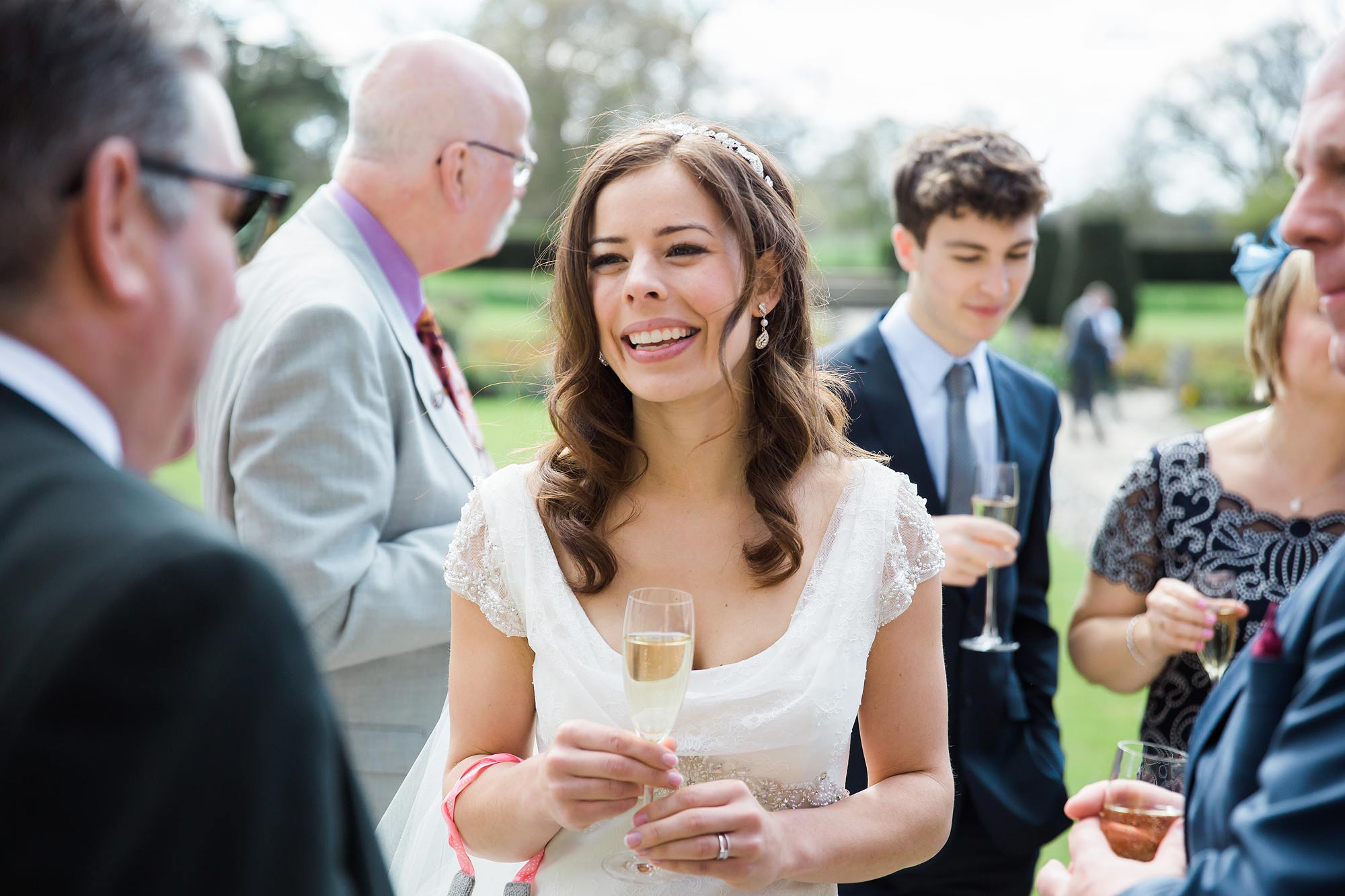 Amy the bride drinking champagne and laughing