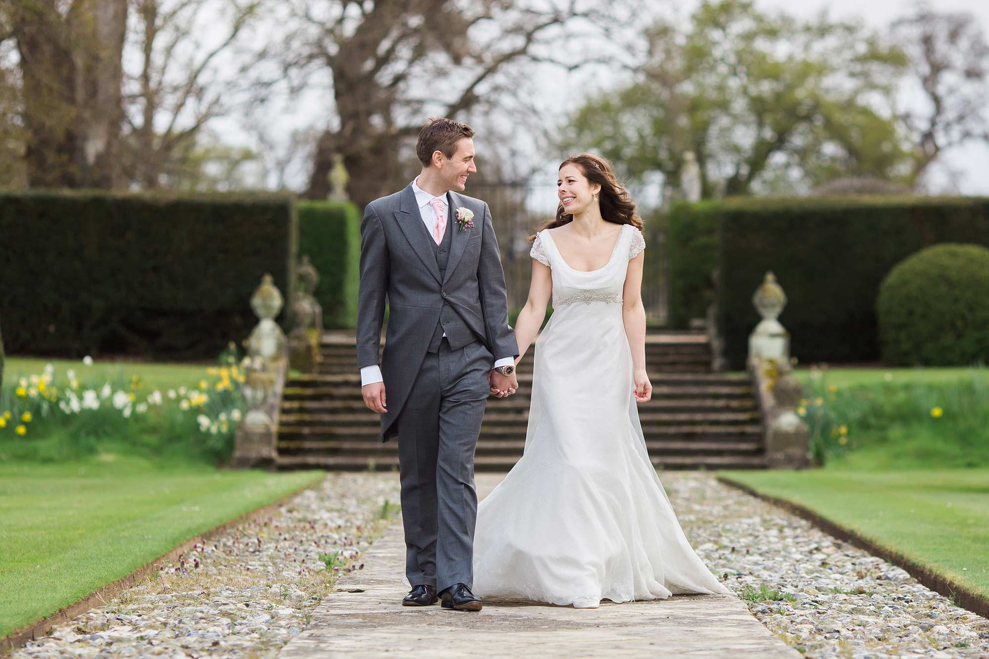 Amy & Jack take a stroll for their official wedding photos at Hengrave Hall