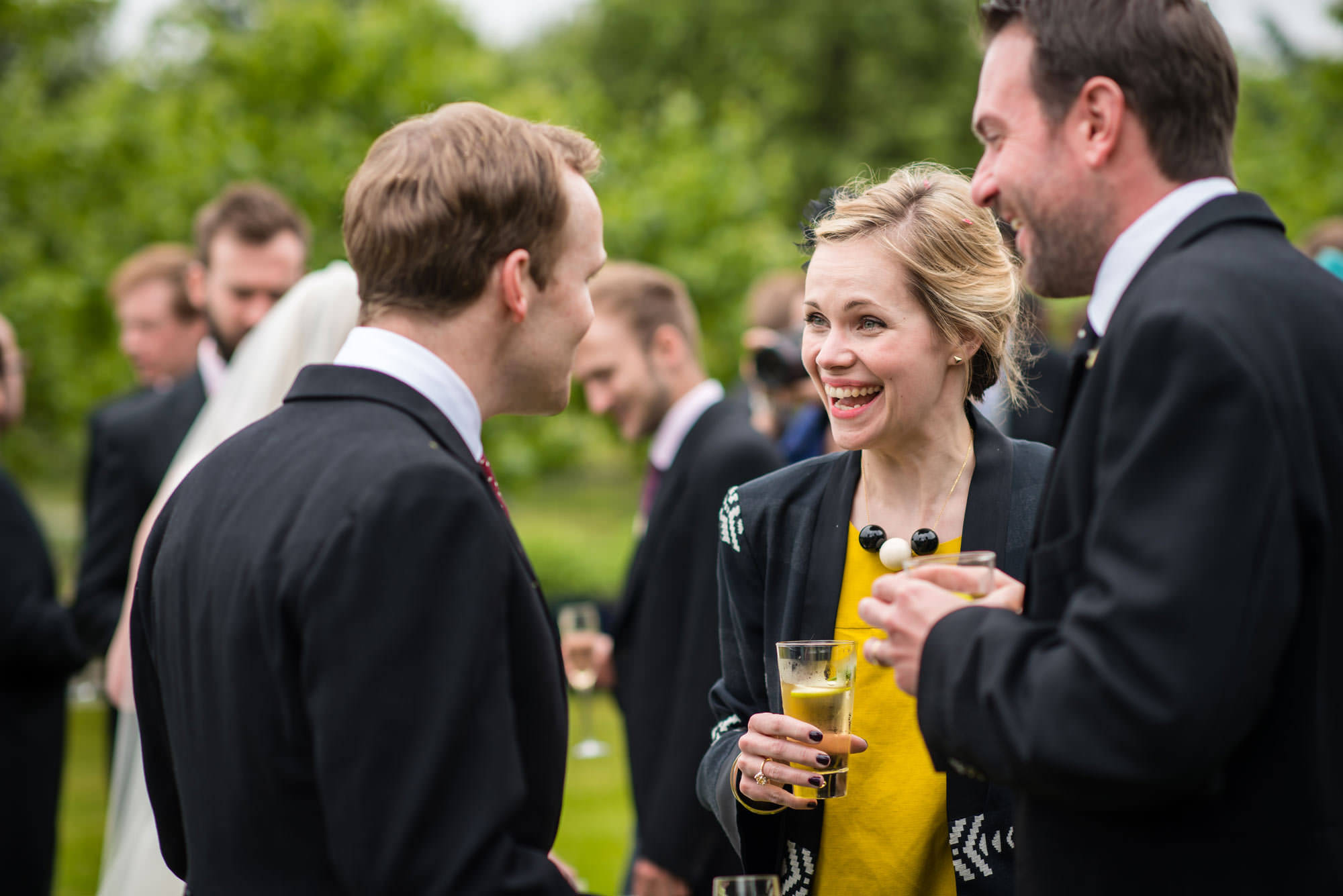 The guest enjoy the champagne at the couples Fulham Palace Wedding