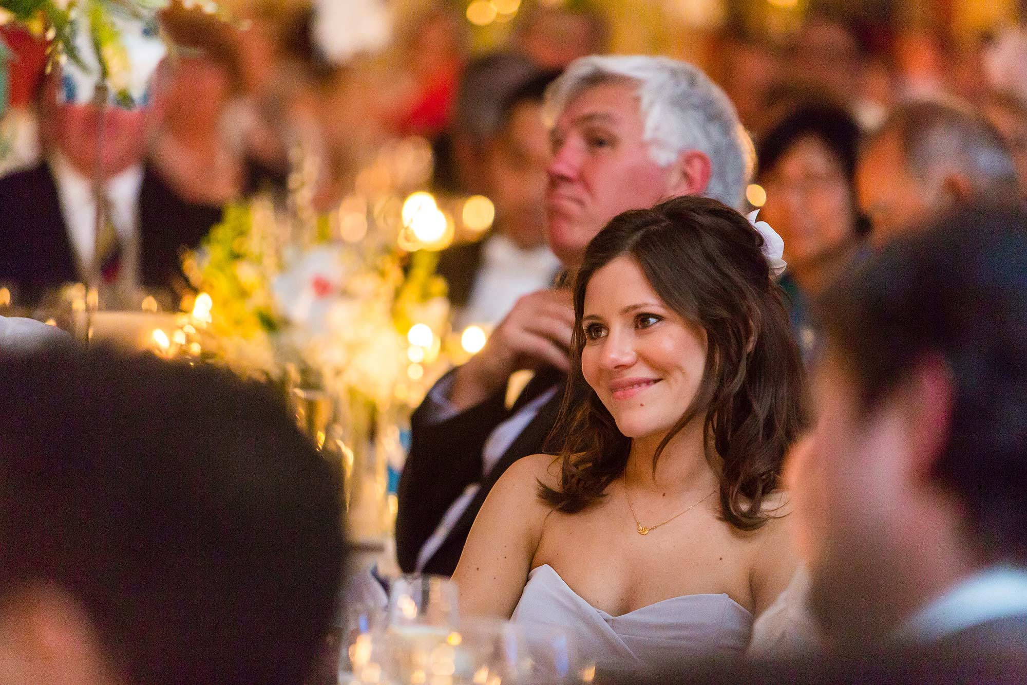 Bridesmaid listens to speeches