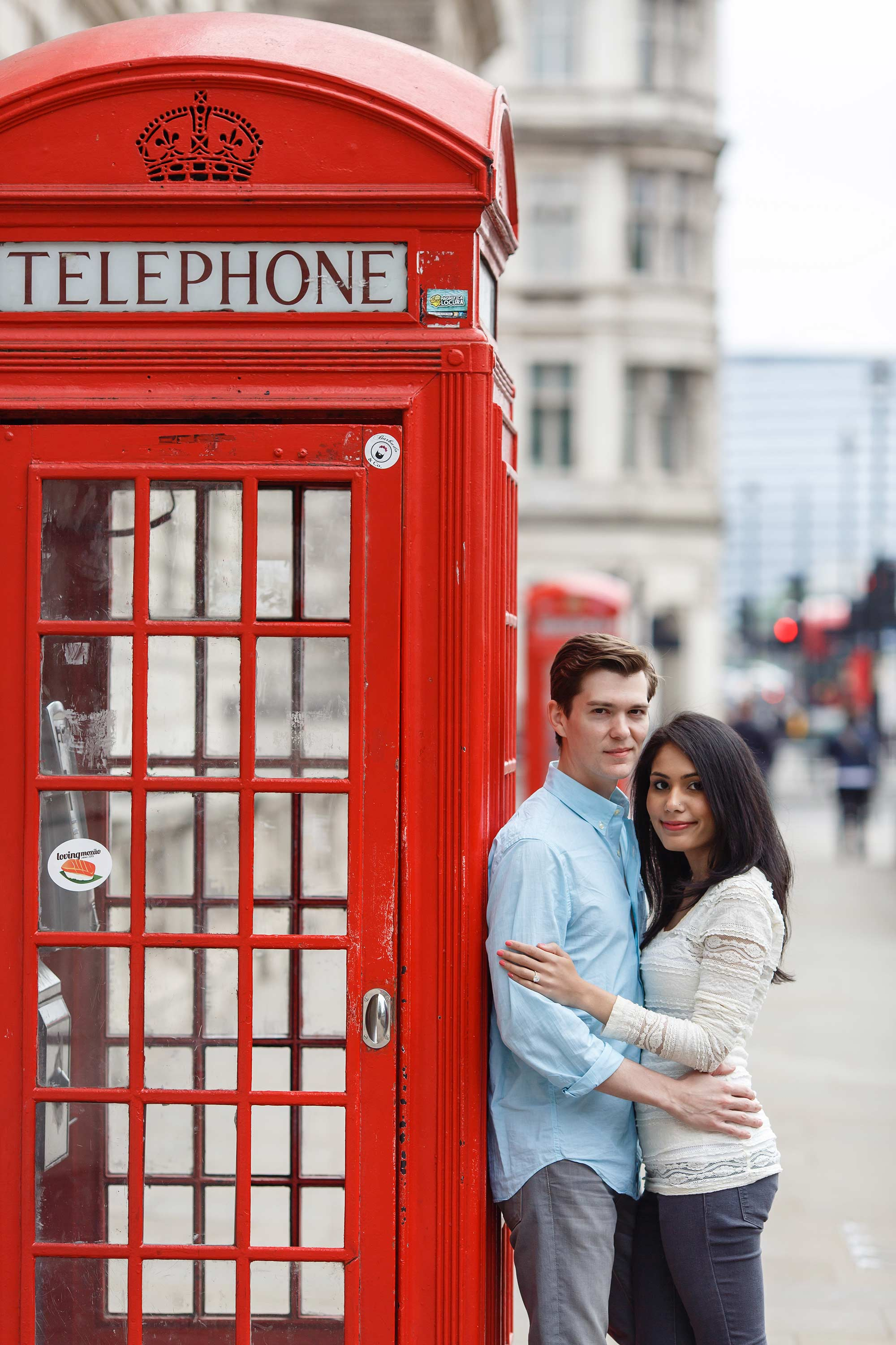The pose in front of a red telephone box london