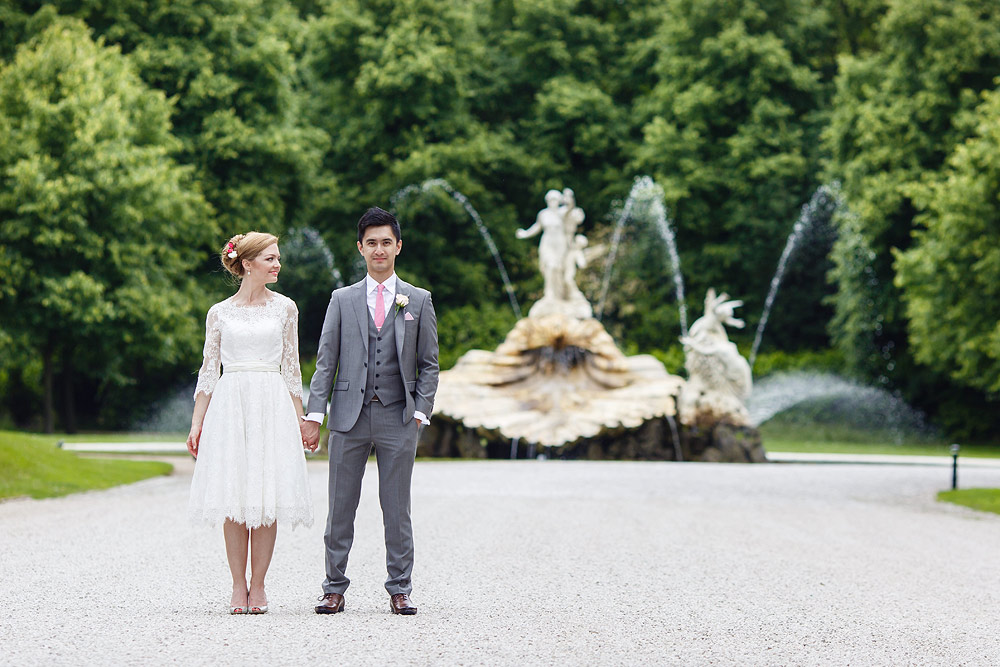 She looks at him in front of the Cliveden House fountain
