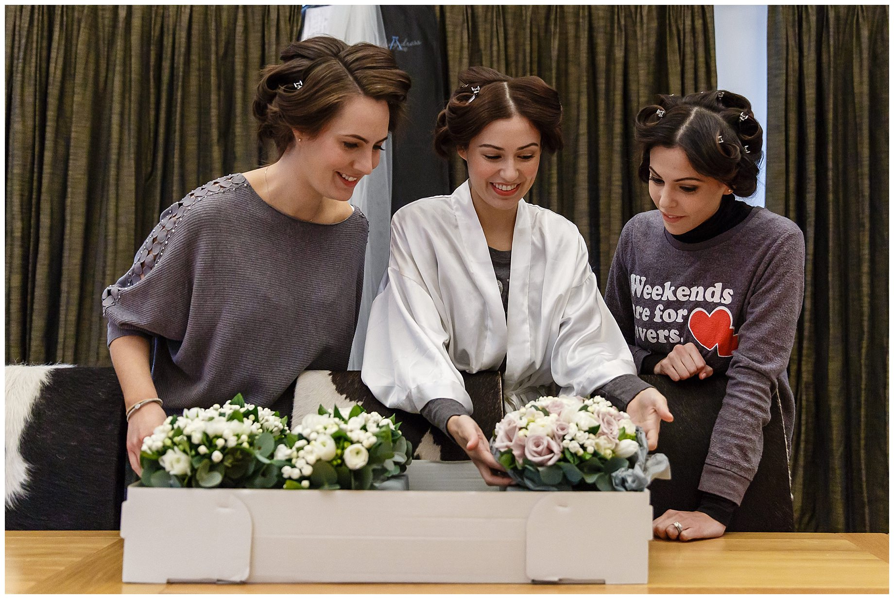 bride inspects flowers at Wasing Park Winter Wedding