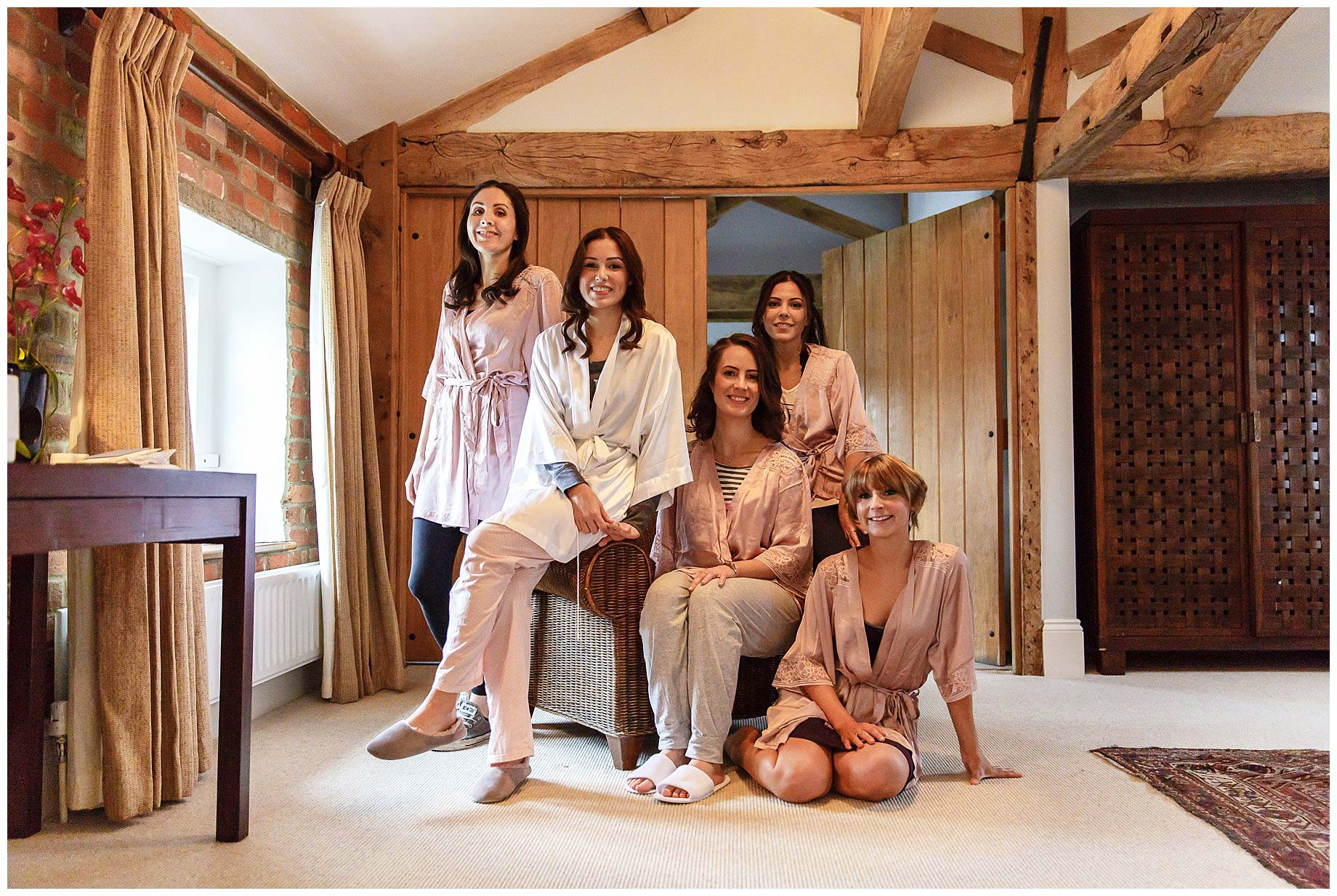 girls in dressing gowns pose for the camera