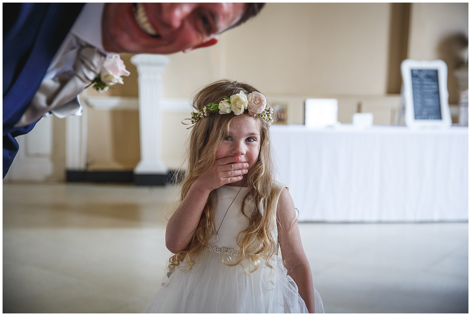 flower girl looks at camera