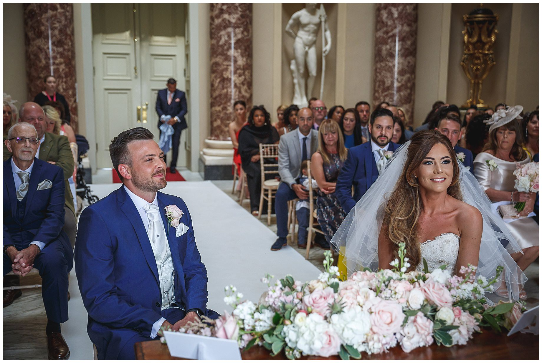 The couple begin the wedding ceremony at Stowe House