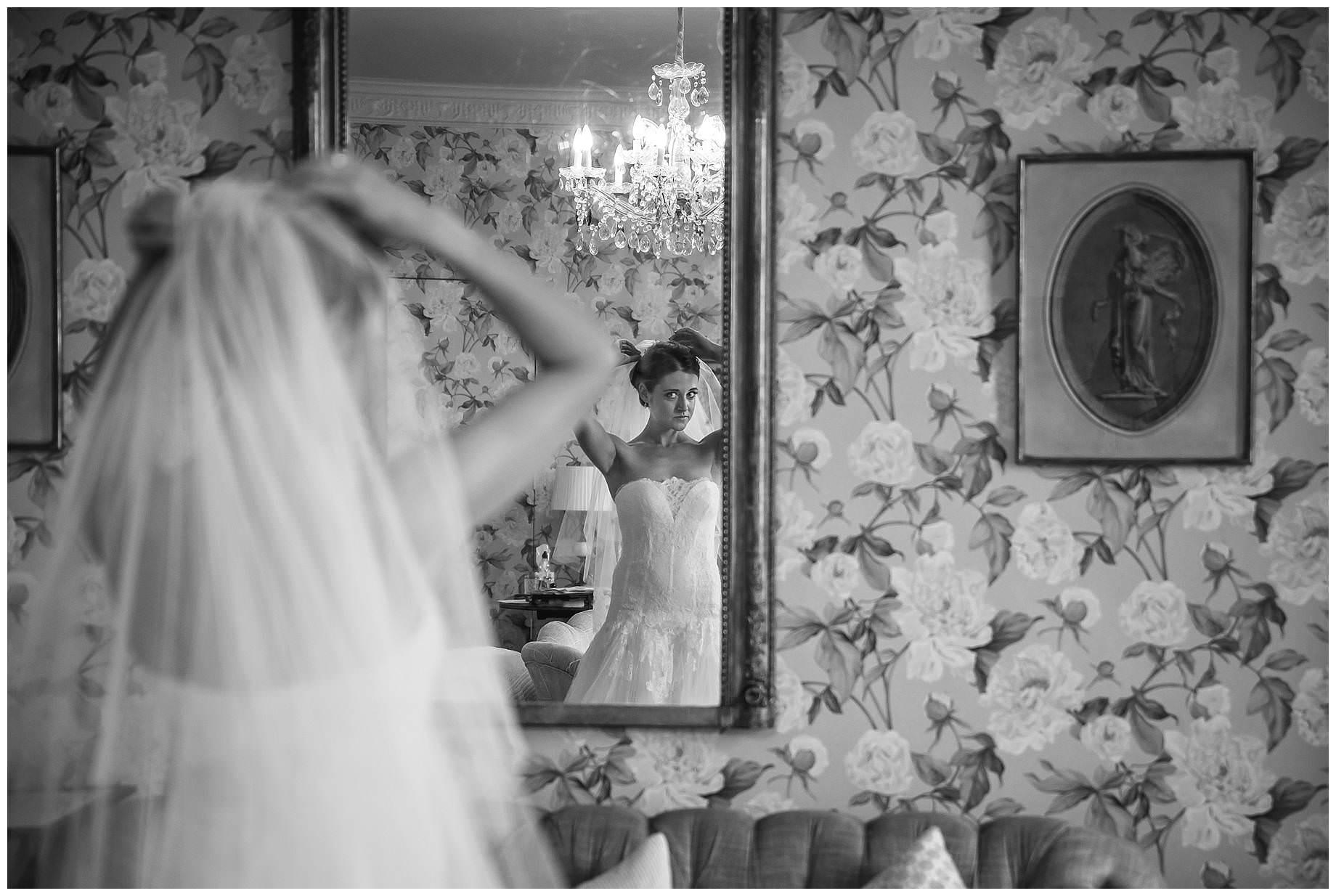 bride adjusting her veil
