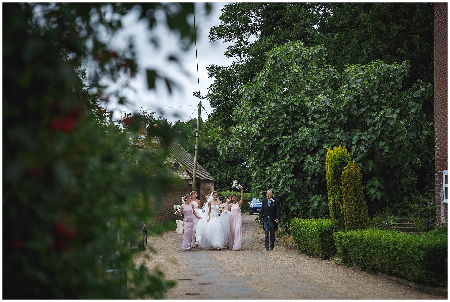 Goodnestone Park Wedding bride makes her way to the church