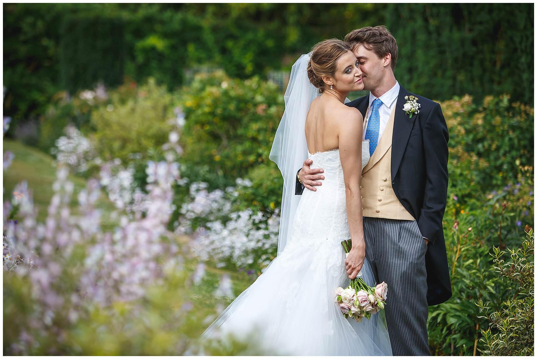 bride and groom in flowers