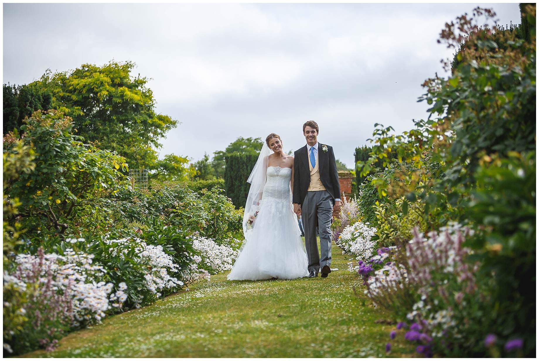 Goodnestone Park Wedding bride and groom walking