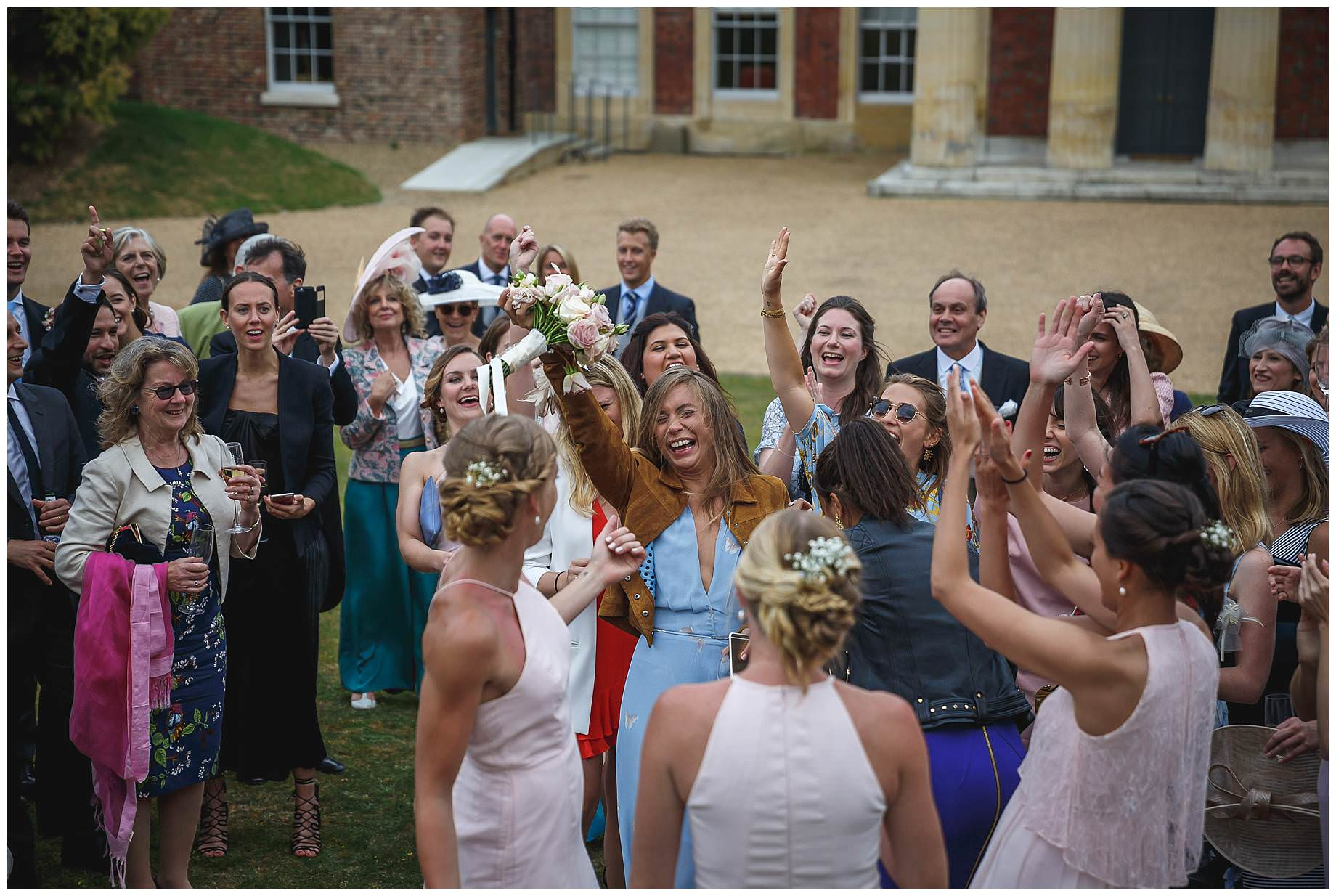 one girl catches the bouquet
