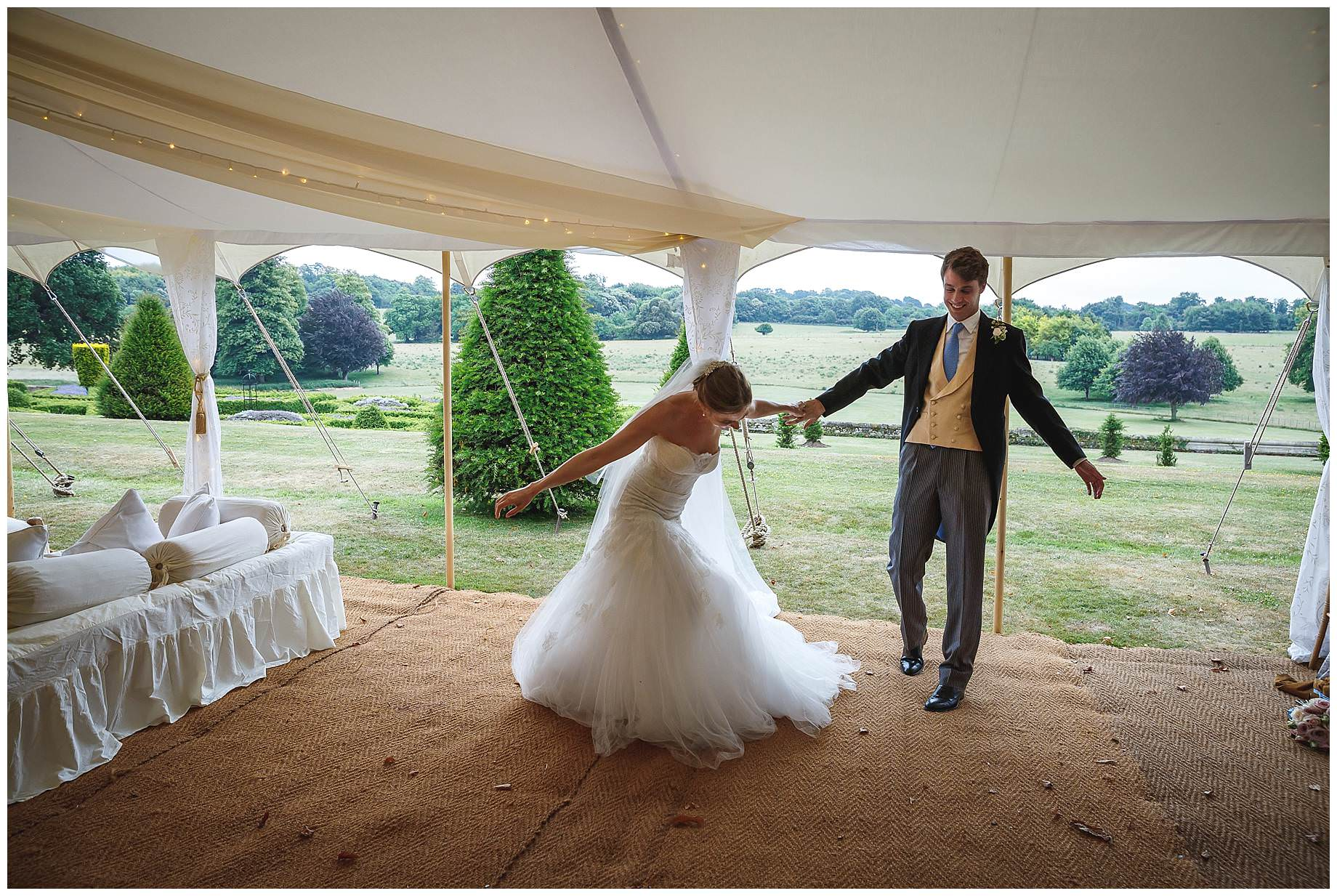 bride and groom enter the marquee
