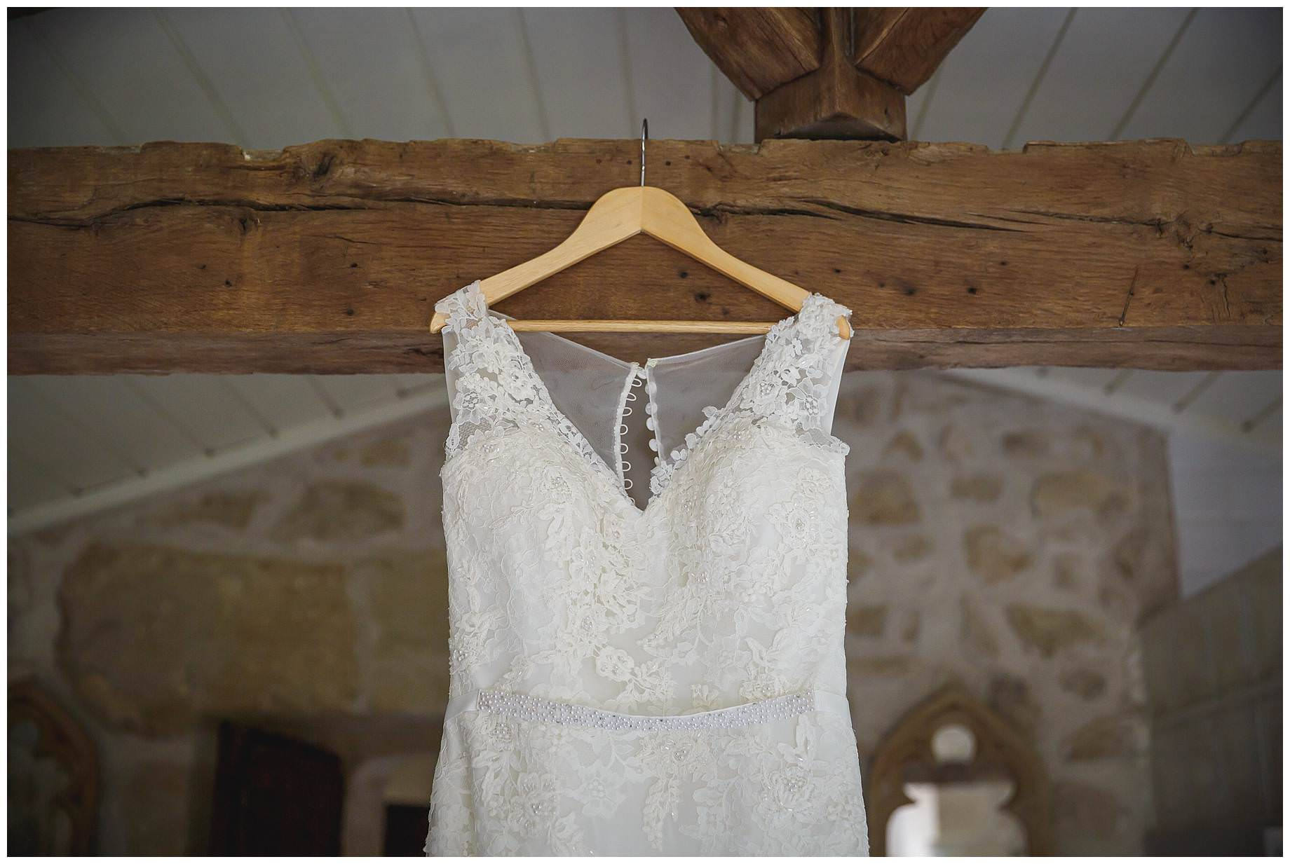 The wedding dress hanging up