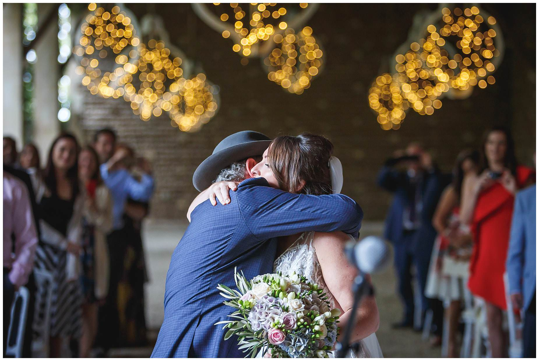 dad hugs bride at chateau de Vergieres