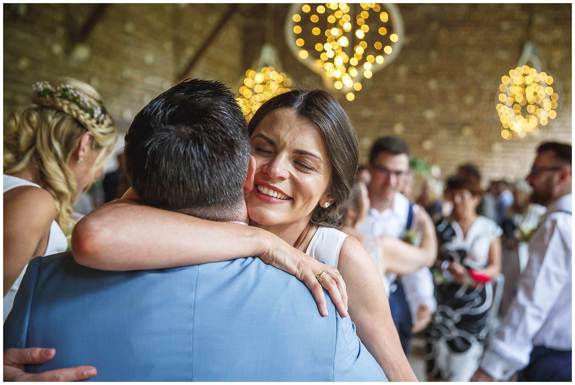 bridesmaid hug groom