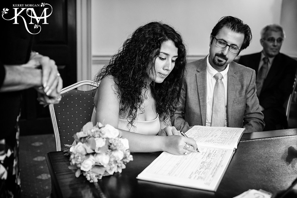 bride signs wedding register at wedding at Merton Register Office wedding