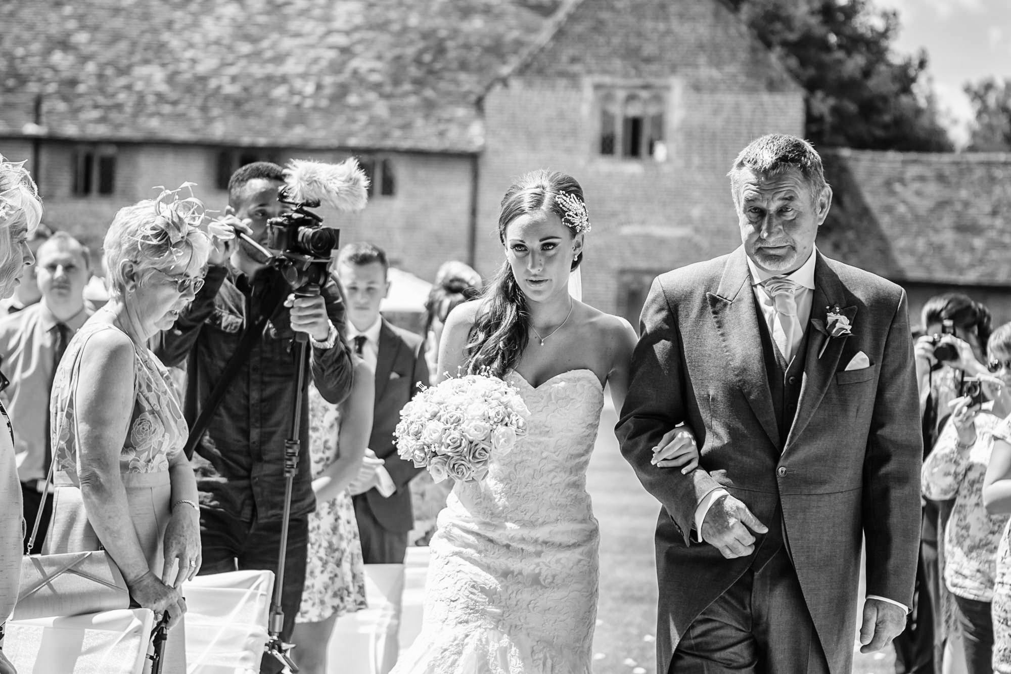walking down the aisle at Leez Priory Wedding