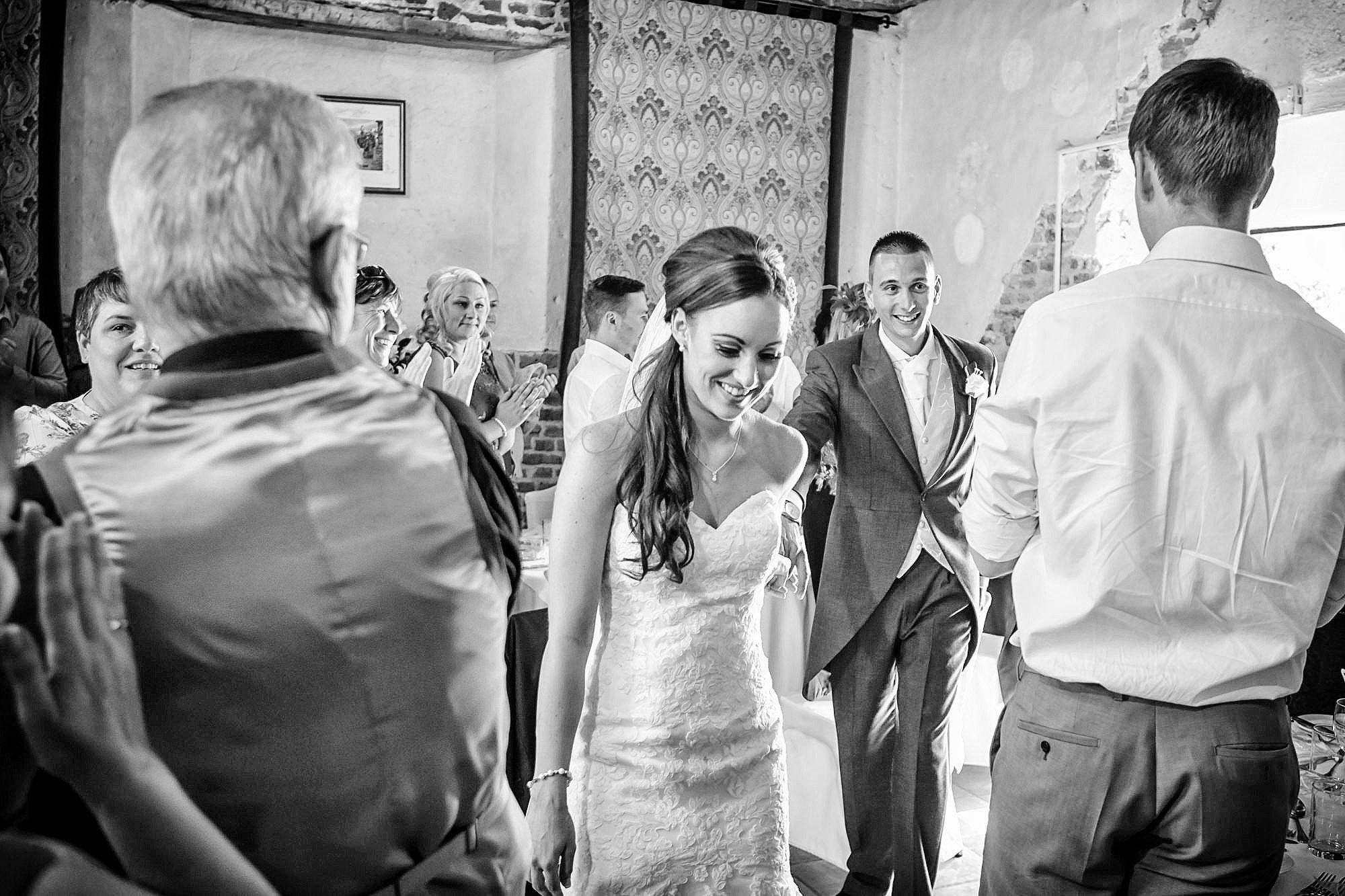 enter the wedding breakfast at Leez Priory Wedding