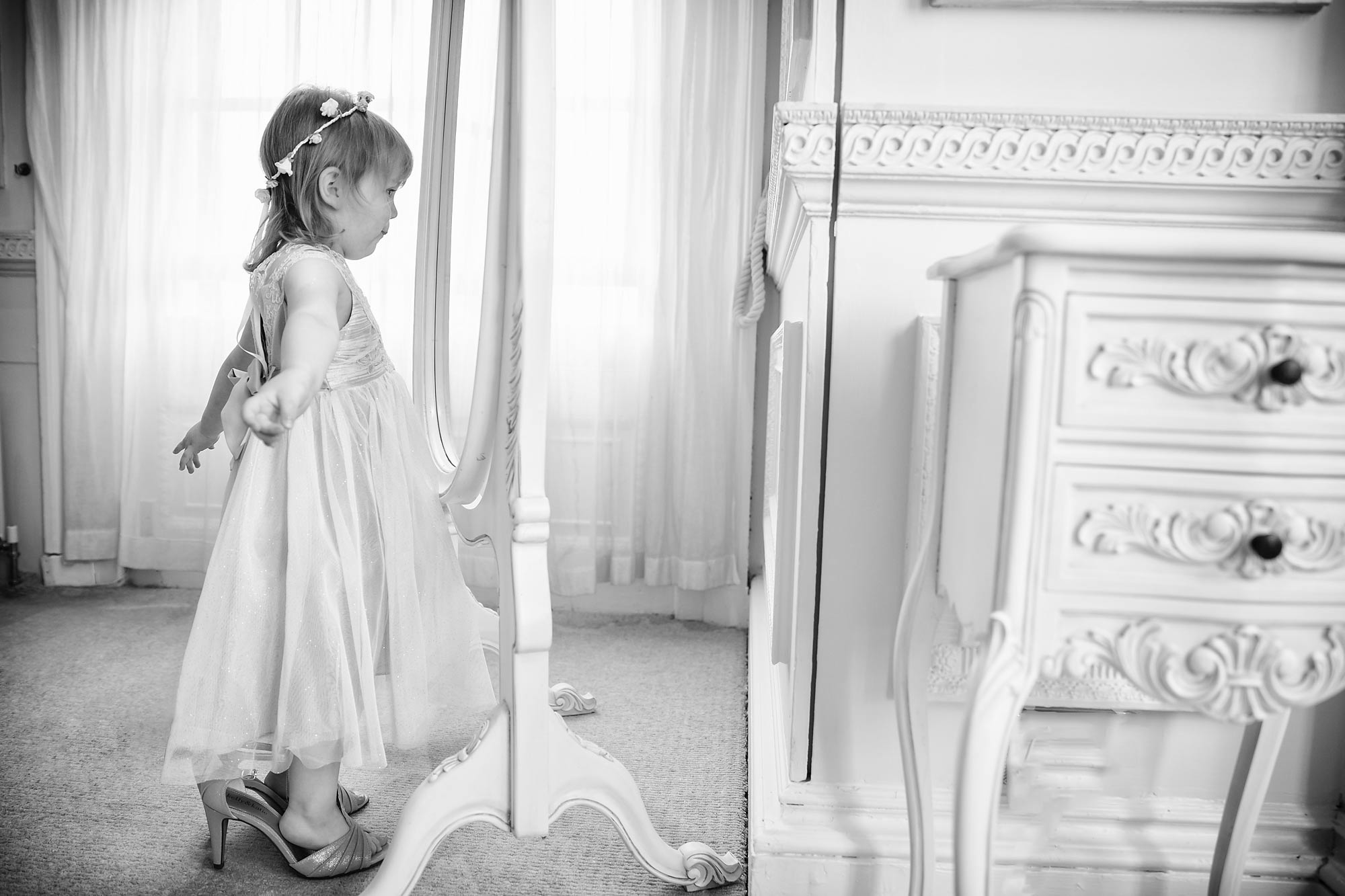 flower girls looking in mirror at Hedsor House Wedding