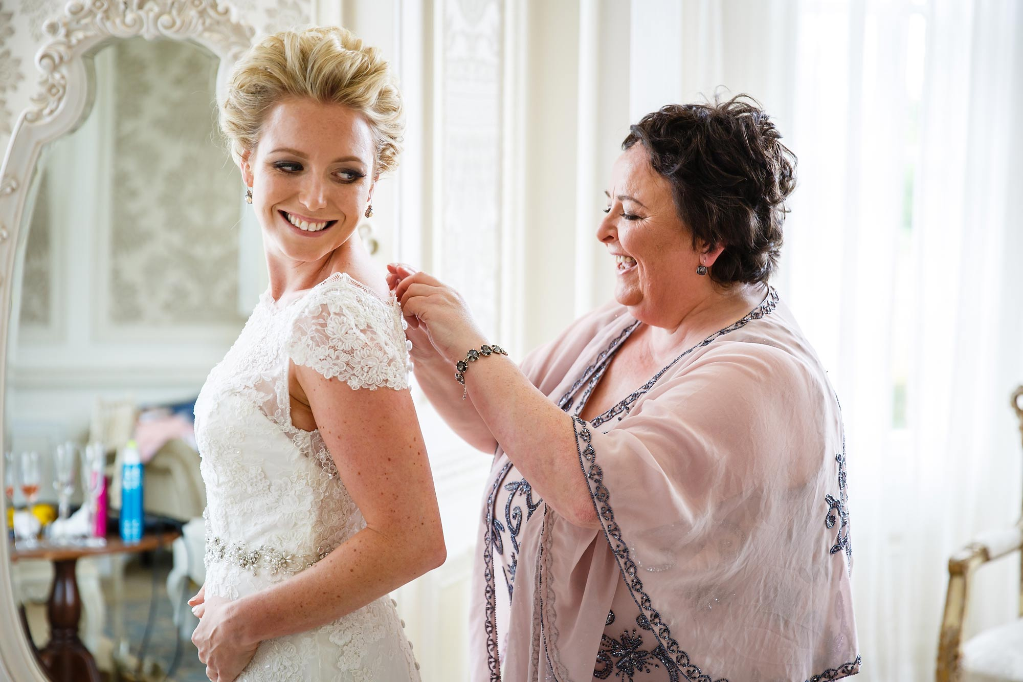 mum gets bride in dress Hedsor House Wedding