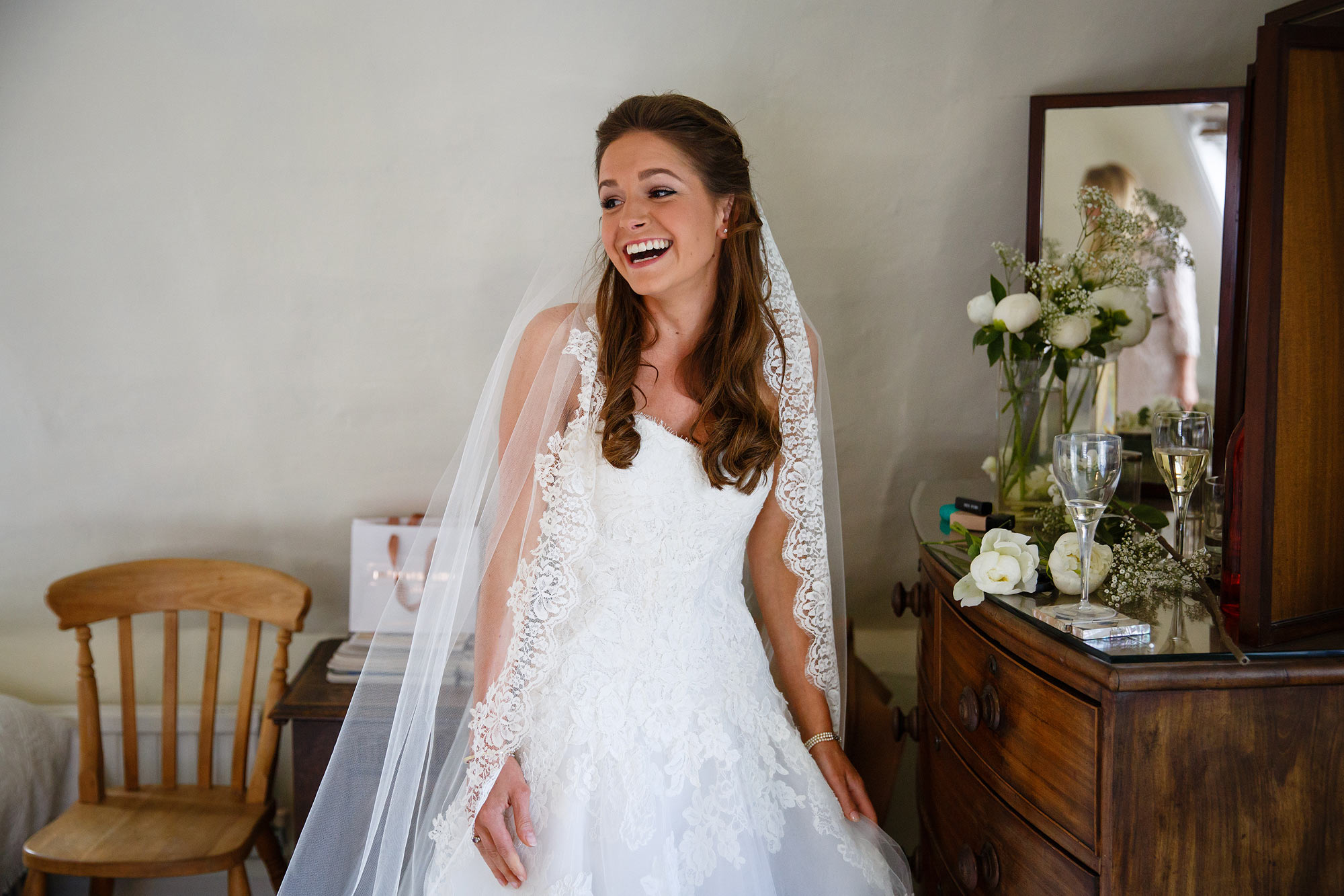 bride laughing wedding at home in kent