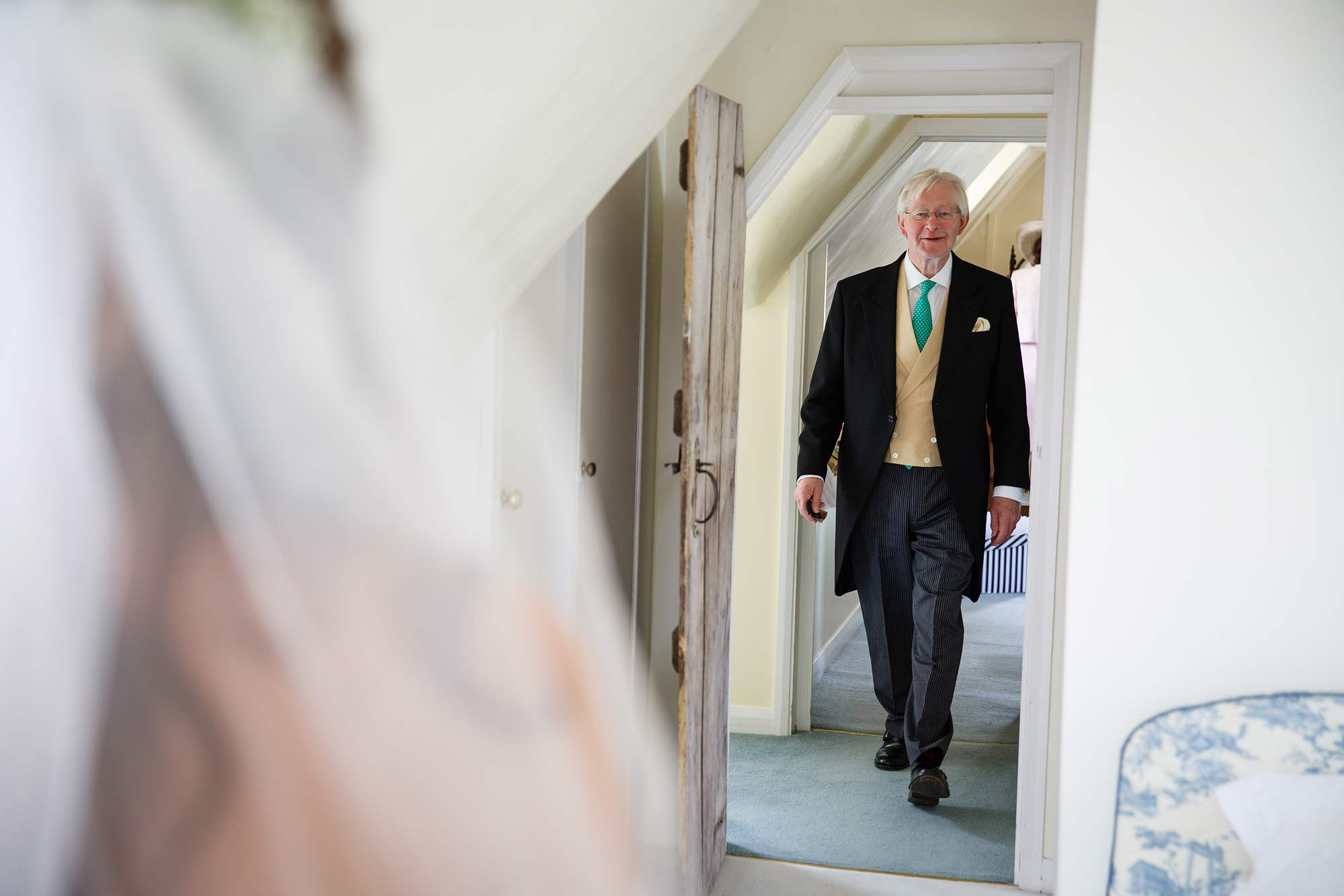 father of the bride sees his daughter for the first time in wedding dress.