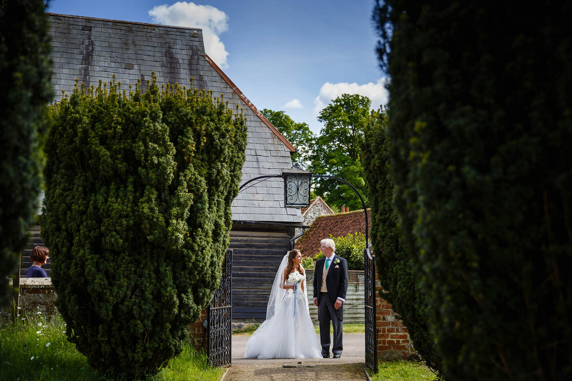 Kent Wedding Photographer shoots bride and dad at church
