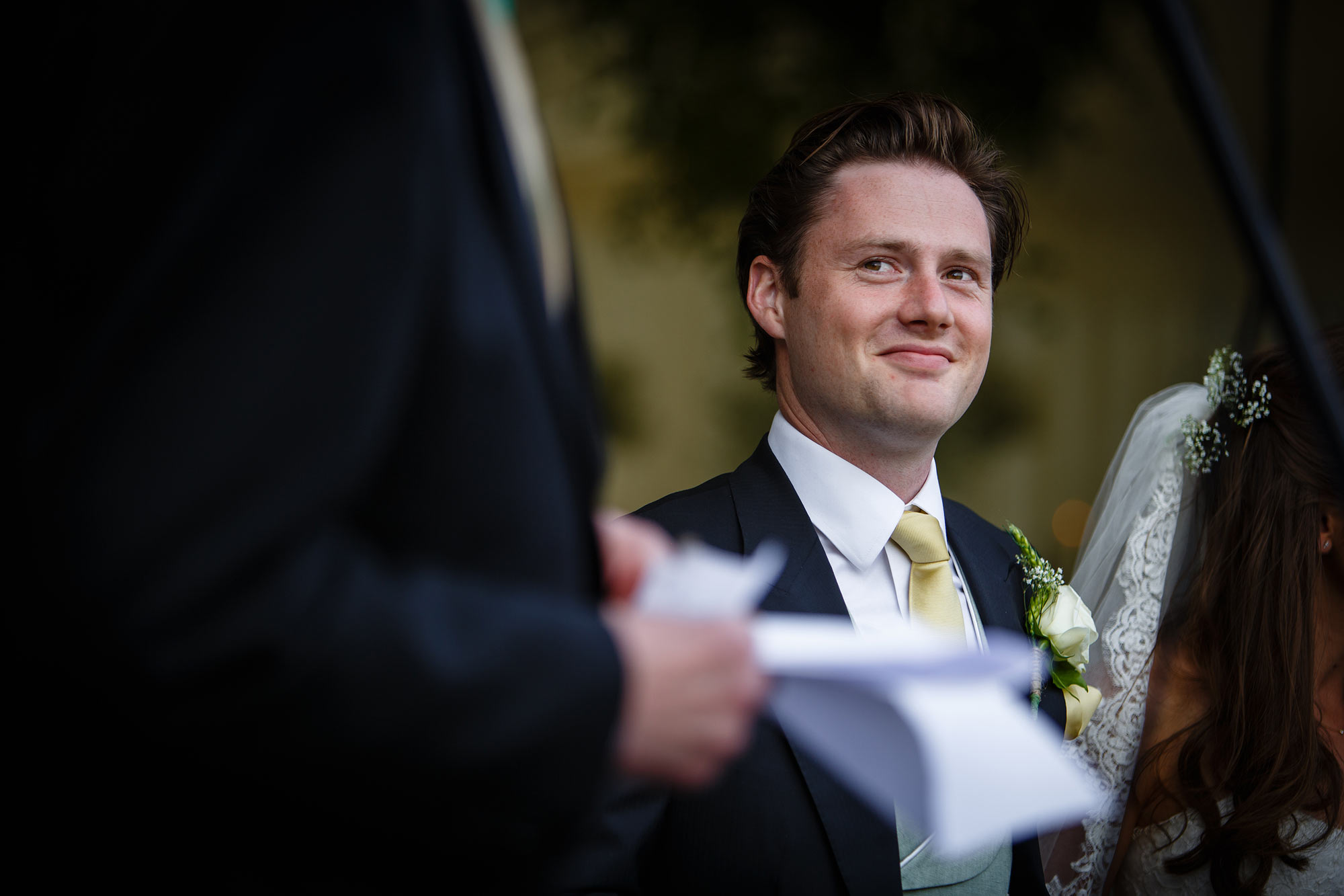 the groom listens to speech
