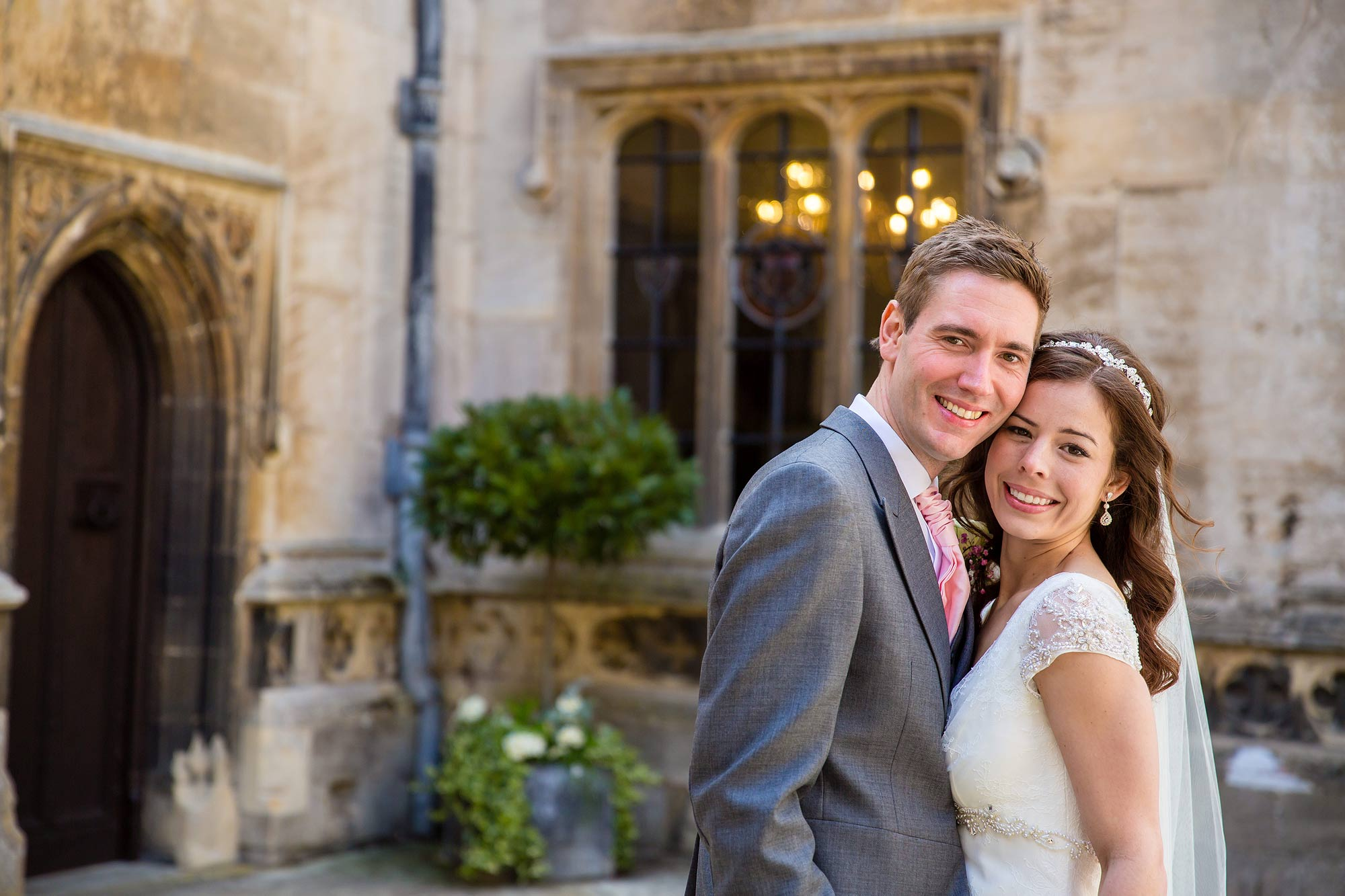 A close up picture of Amy and Jack in the courtyard at Hengrave Hall
