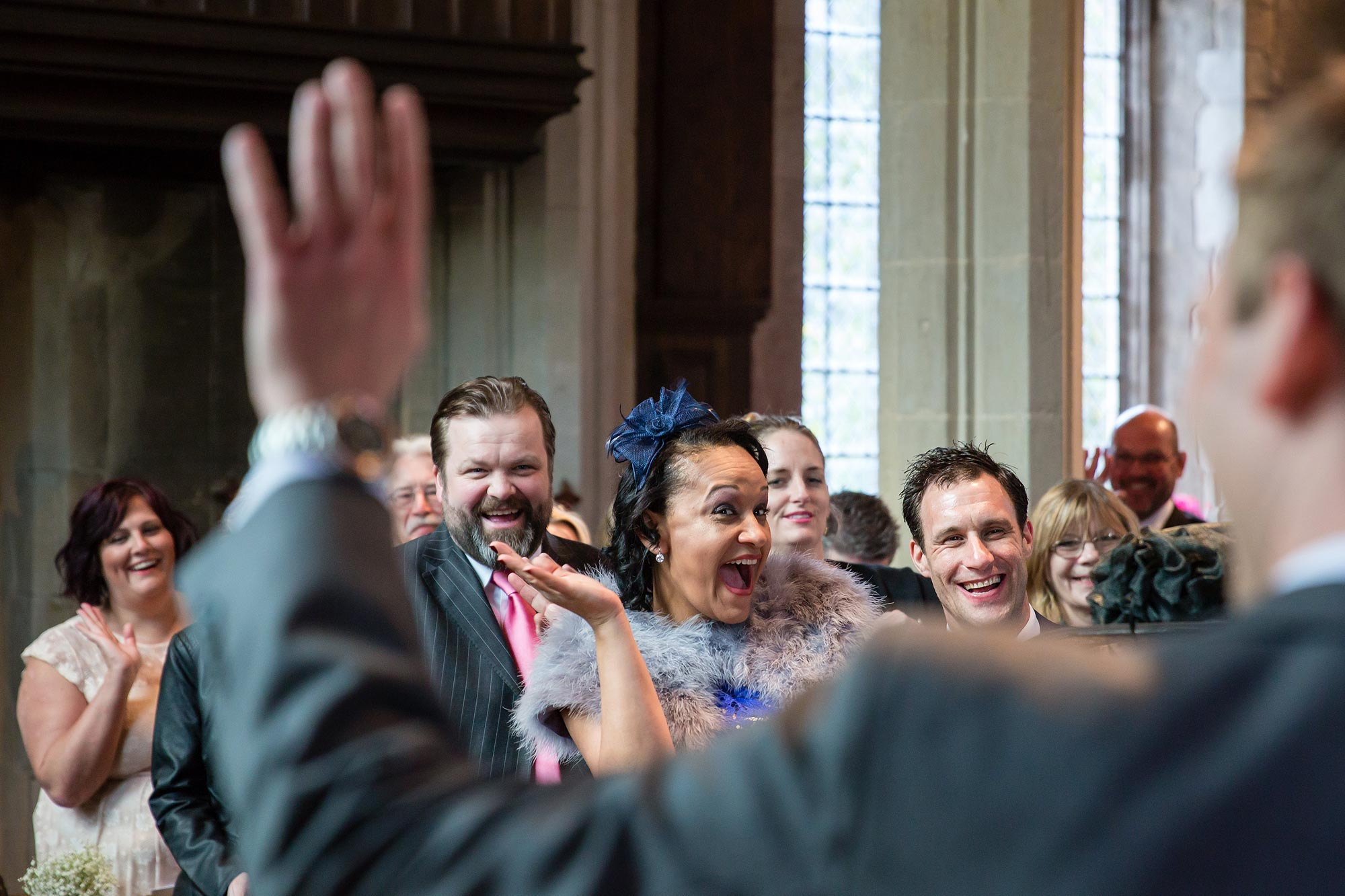 Guests wave during the Hengrave Hall wedding
