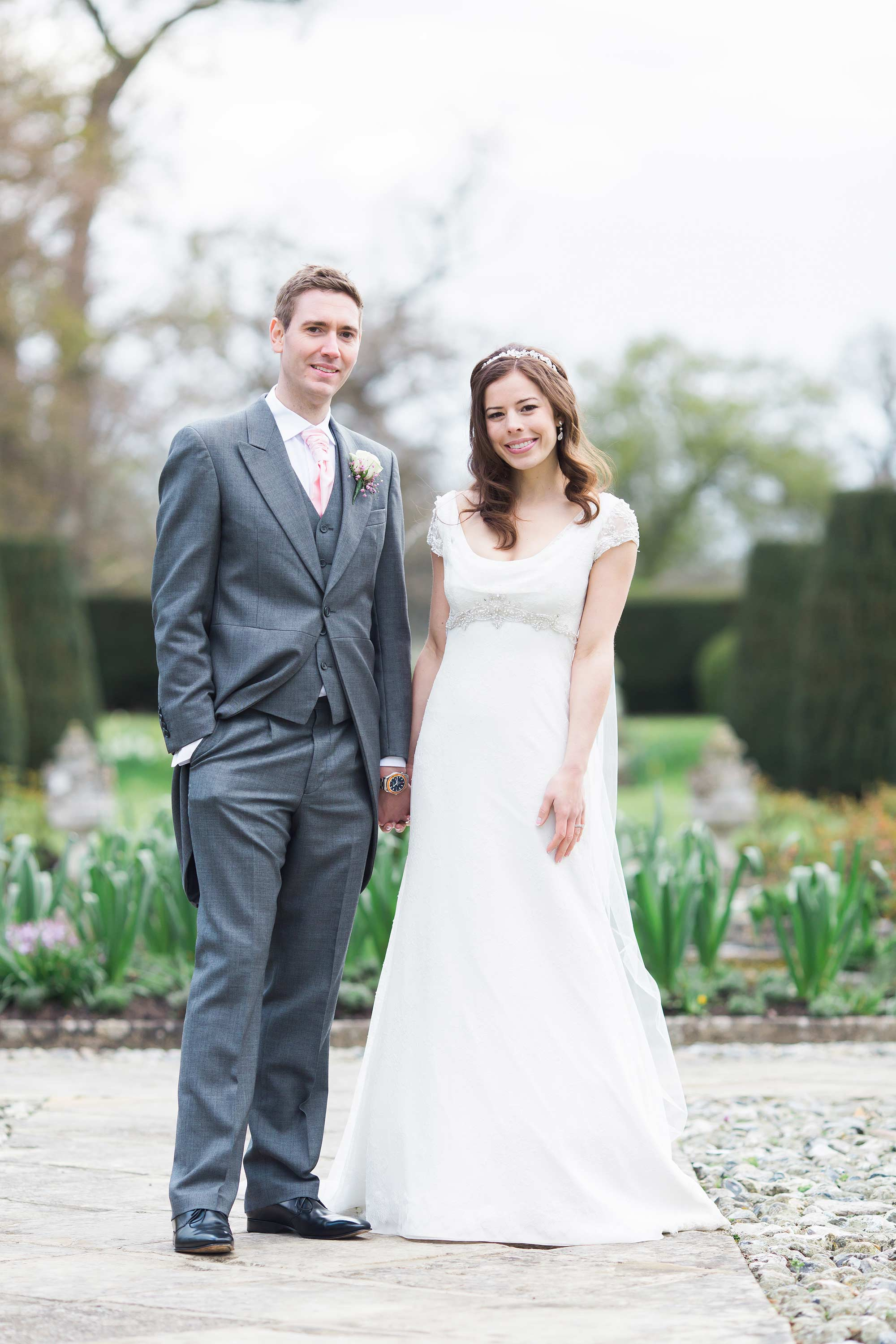 Amy and Jack a full length wedding photo taken at Hengrave Hall