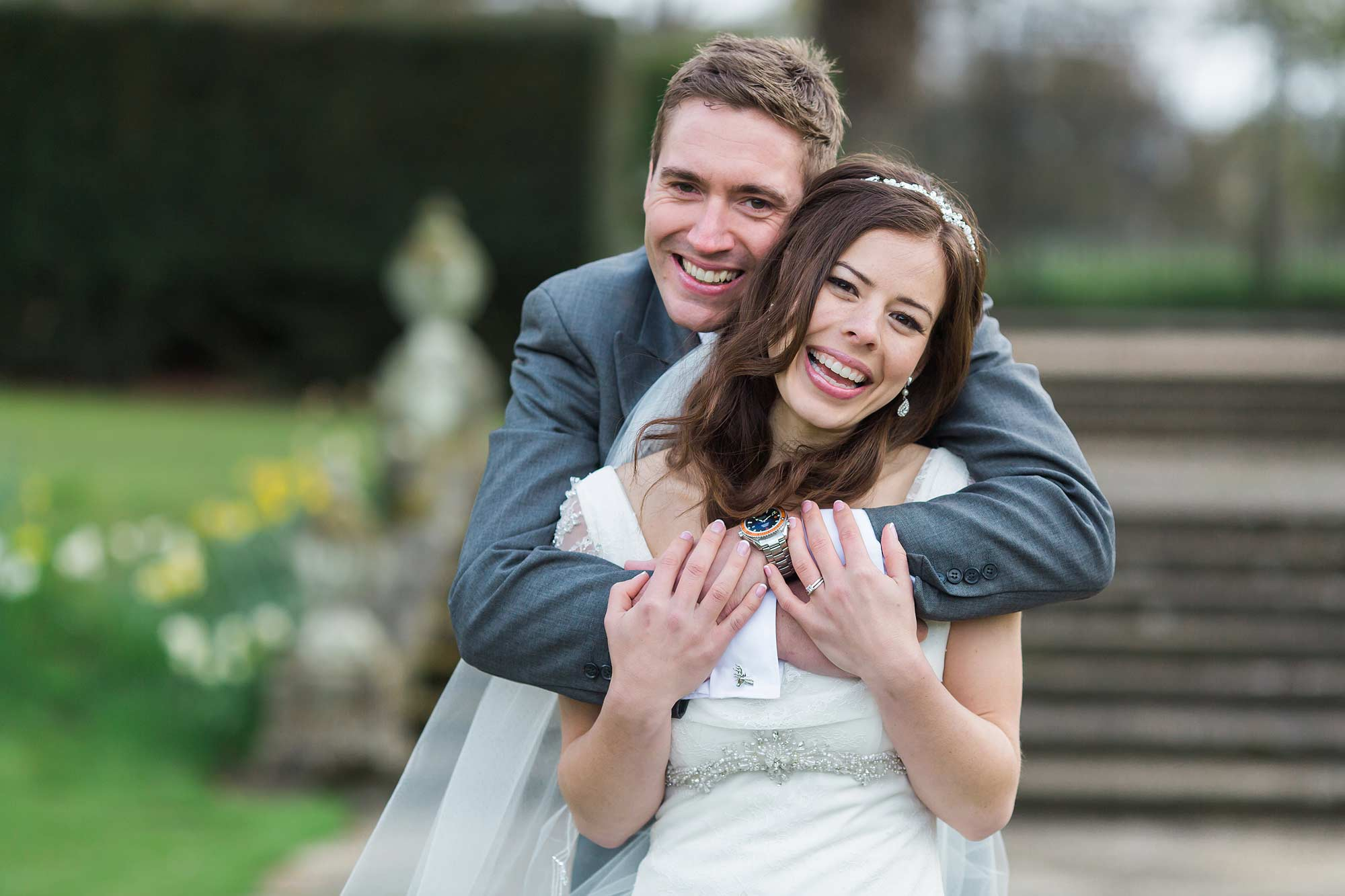 Amy and Jack pose for a picture to commemorate their Hengrave Hall Wedding.
