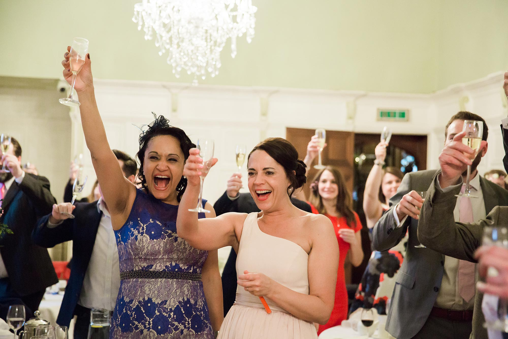 The guest toasting to the couple at Hengrave Hall Wedding