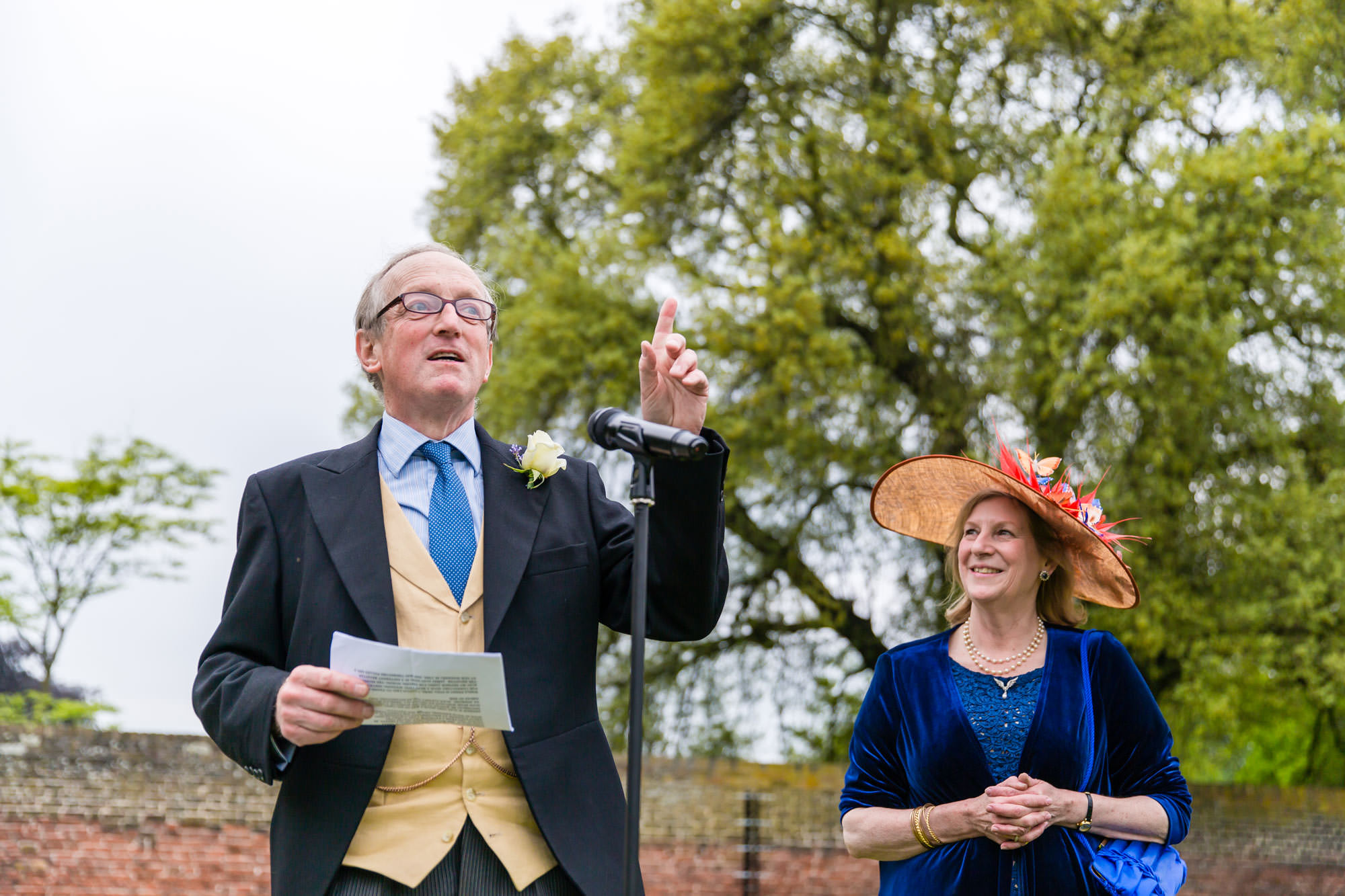 The Father of the bride gives his speech in the walled garden of Fulham Palace
