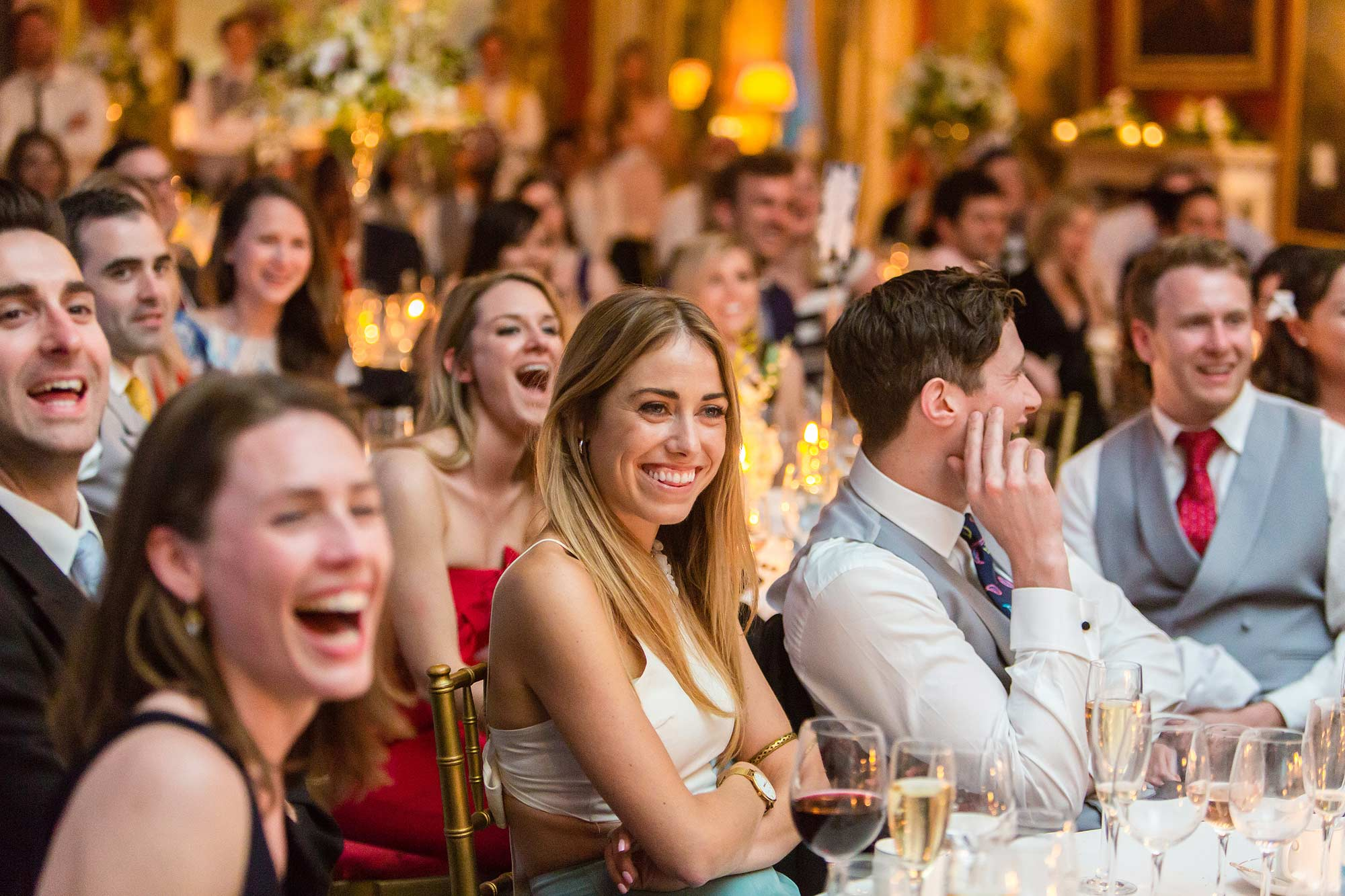 guests laughing at slideshow