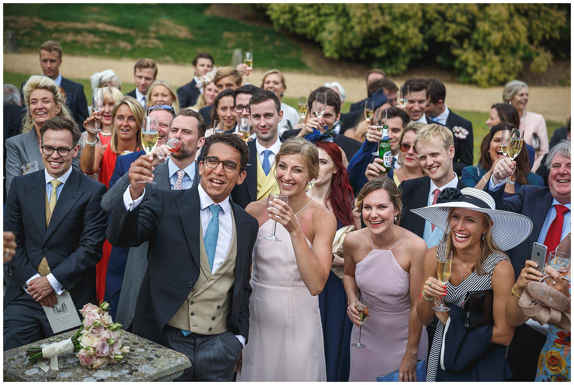 all guests raise a glass of champagne in a toast