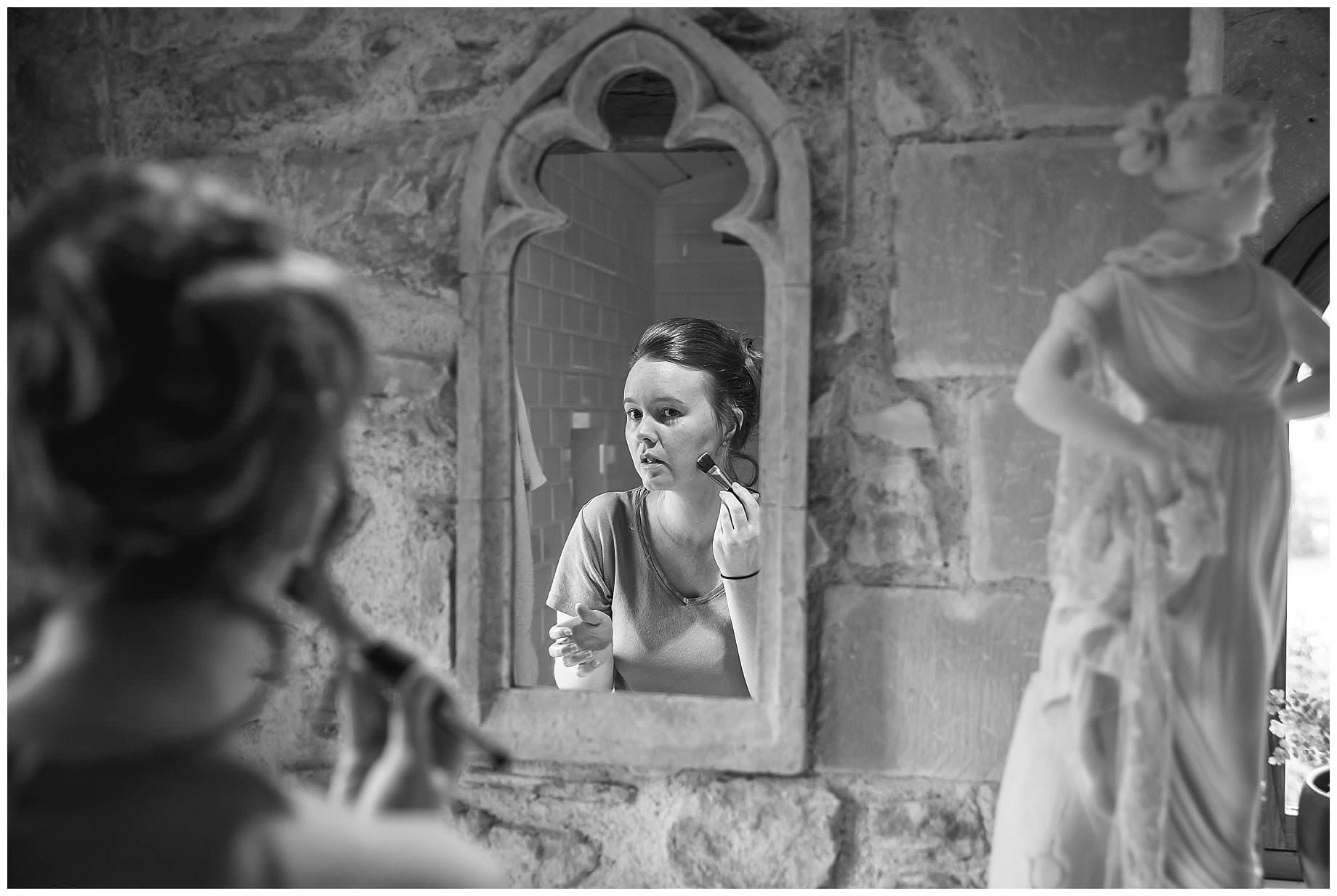 bride getting ready at Chateau Brametourte Wedding