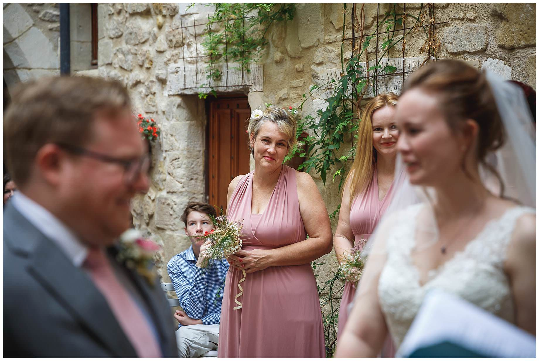guests watch the wedding at Chateau Brametourte