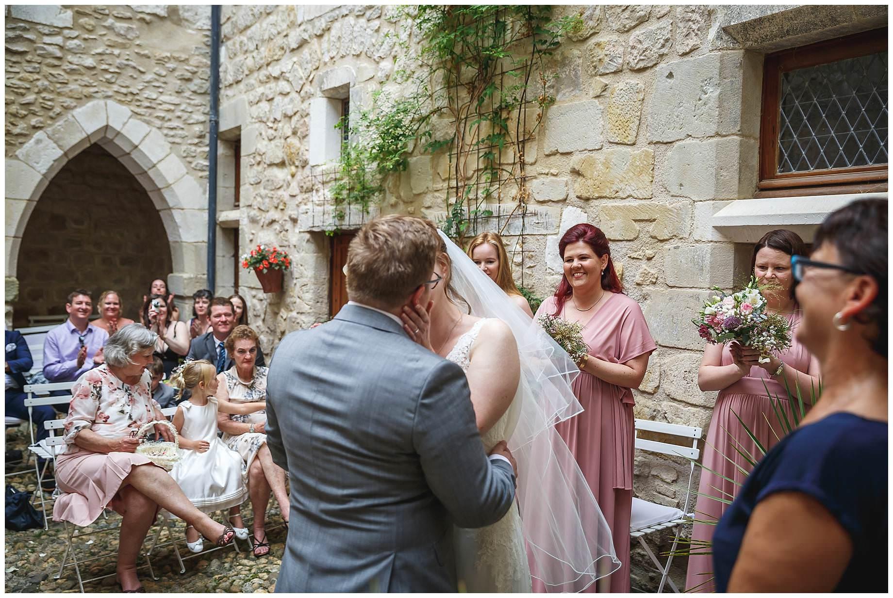 bride and groom kiss at Chateau Brametourte Wedding