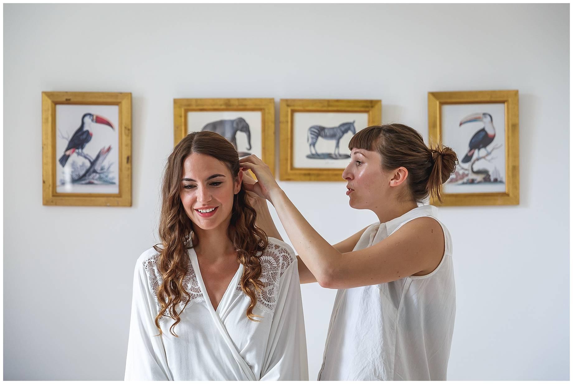 bride getting hair done for Chateau du Bijou Wedding