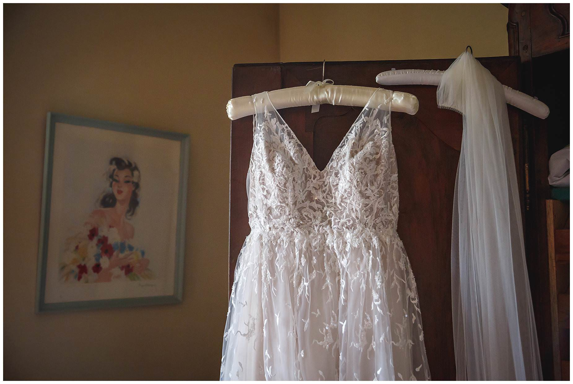 wedding dress hanging at chateau de Vergieres